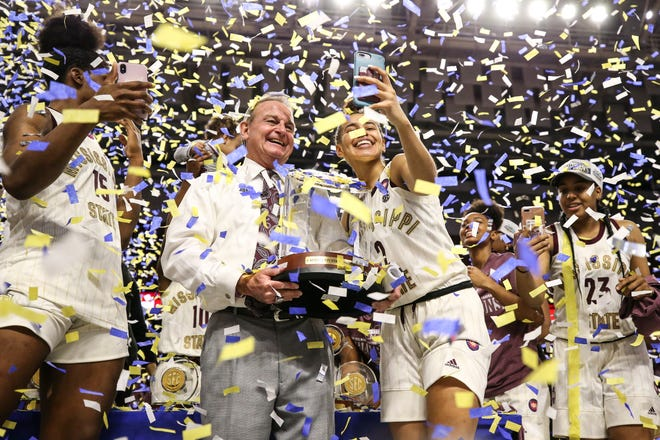 Mississippi State head coach Vic Schaefer celebrates the program's first SEC Tournament title with guard Andra Espinoza-Hunter in Greenville, S.C.