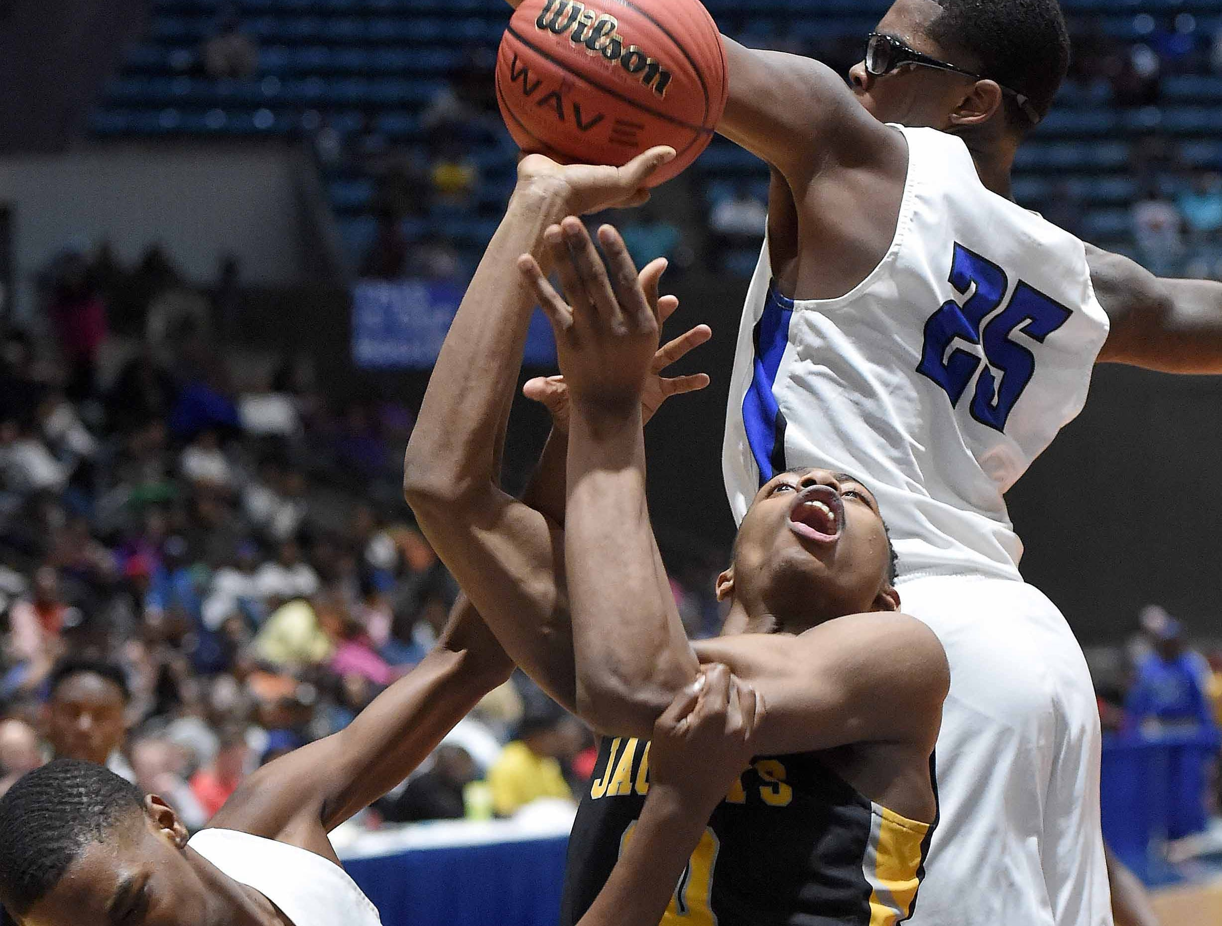 Starkville's Zeke Cook (10) is fouled by Meridian in the Class 6A finals of the MHSAA C Spire State Basketball Championships at the Mississippi Coliseum in Jackson, Miss., on Saturday, March 9, 2019.