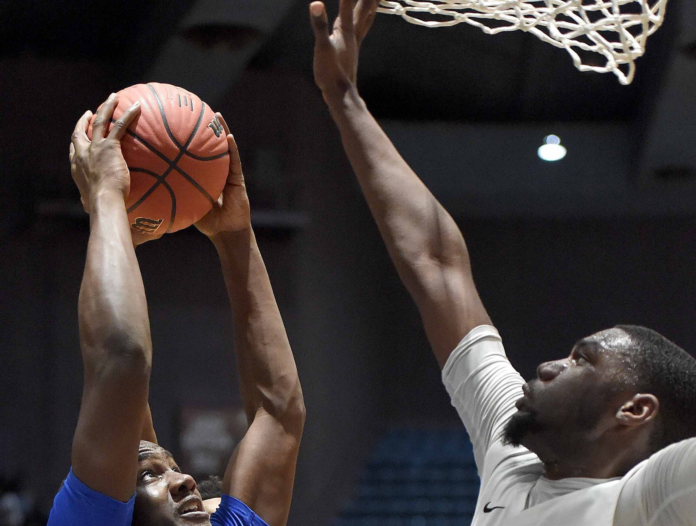 Velma Jackson's Charlie Jones (13) rebounds against Holly Springs' Deveon Miller (22) in the finals of the MHSAA C Spire State Basketball Championships at the Mississippi Coliseum in Jackson, Miss., on Saturday, March 9, 2019.