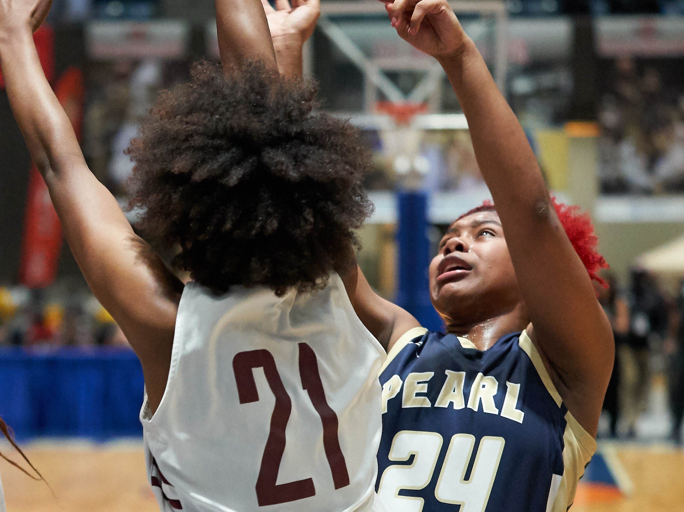 Pearl's Jade Miles (24) shoots against Terry's Ayani Cockerill (21)  during the MHSAA 6A Girls Basketball Championship Finals held at the Mississippi Coliseum in Jackson, MS, Saturday March 9th, 2019.(Bob Smith)