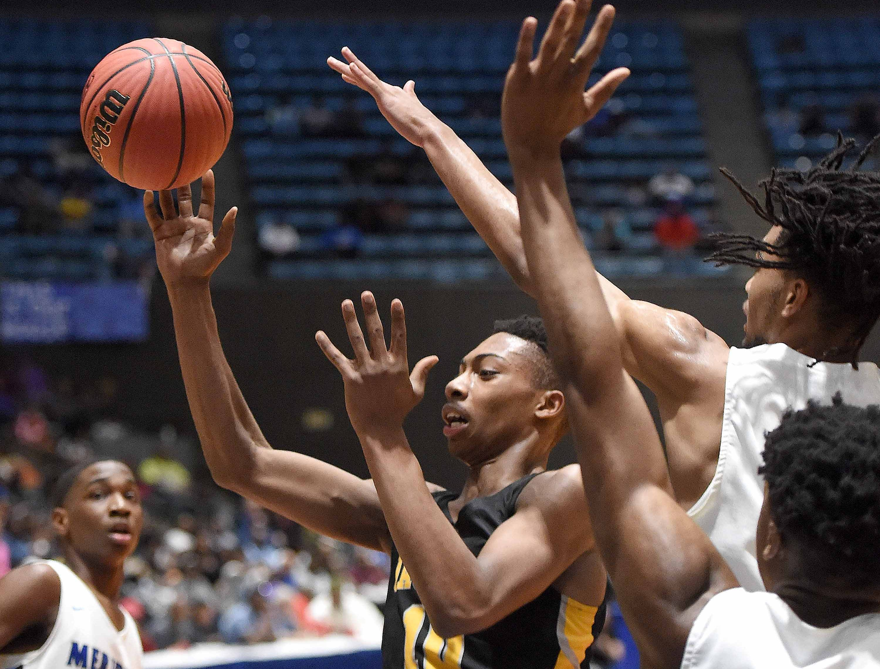 Starkville's Zeke Cook (10) passes away from a Meridian double team in the Class 6A finals of the MHSAA C Spire State Basketball Championships at the Mississippi Coliseum in Jackson, Miss., on Saturday, March 9, 2019.