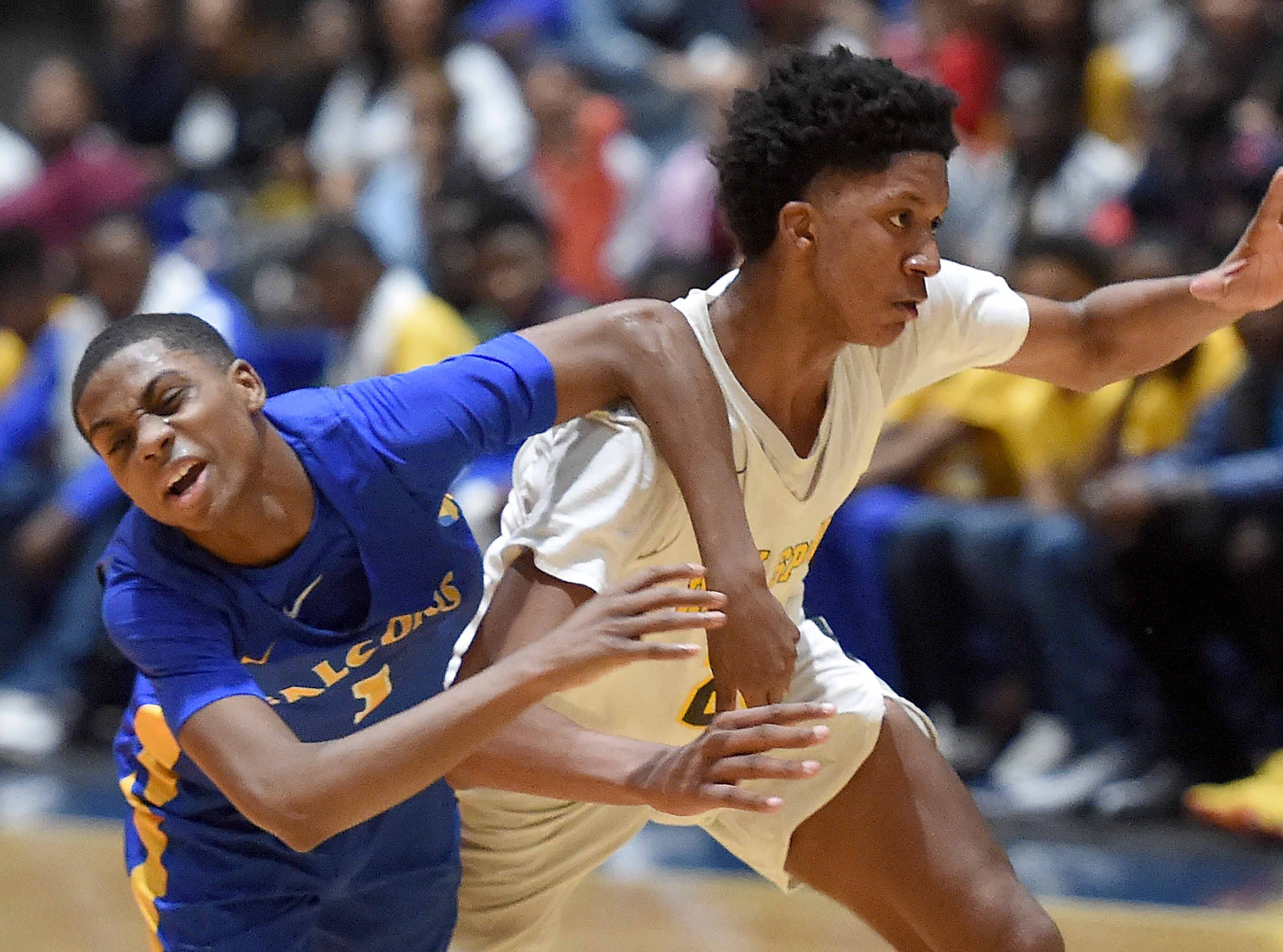 Holly Springs' Derek Fountain (20) steals the ball against Velma Jackson in the finals of the MHSAA C Spire State Basketball Championships at the Mississippi Coliseum in Jackson, Miss., on Saturday, March 9, 2019.