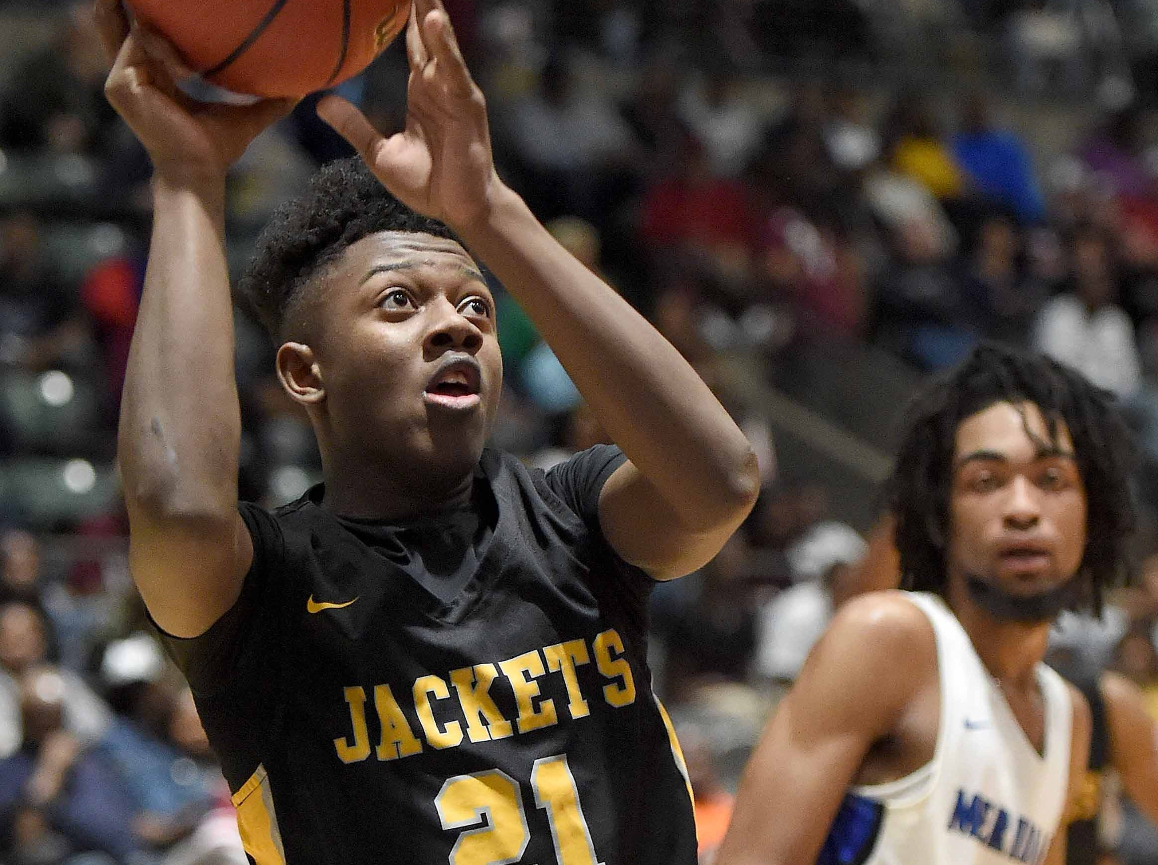 Starkville's Eric Green (21) shoots against Meridian in the Class 6A finals of the MHSAA C Spire State Basketball Championships at the Mississippi Coliseum in Jackson, Miss., on Saturday, March 9, 2019.
