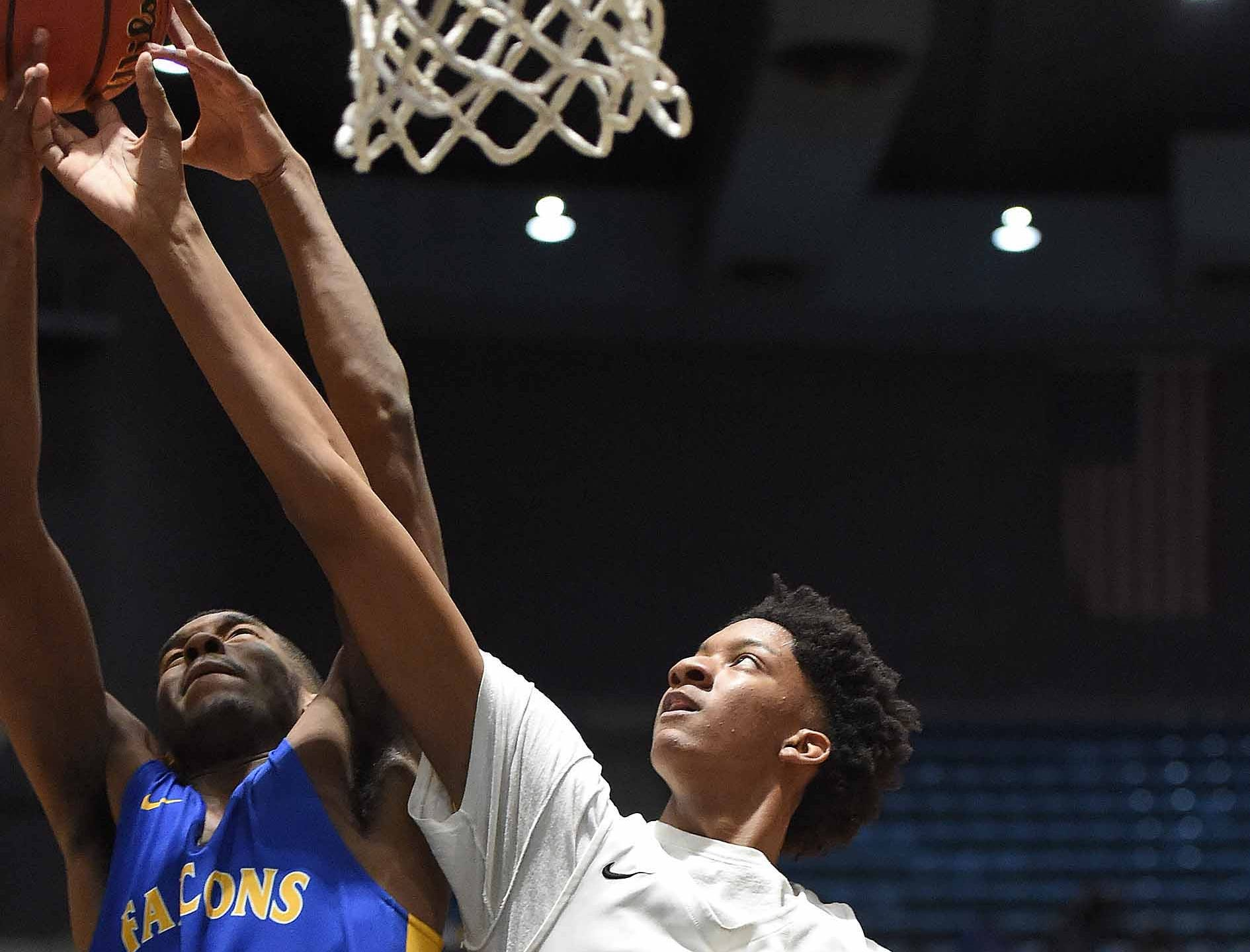 Holly Springs' Derek Fountain (20) rebounds against Velma Jackson's Joshua Lee in the finals of the MHSAA C Spire State Basketball Championships at the Mississippi Coliseum in Jackson, Miss., on Saturday, March 9, 2019.