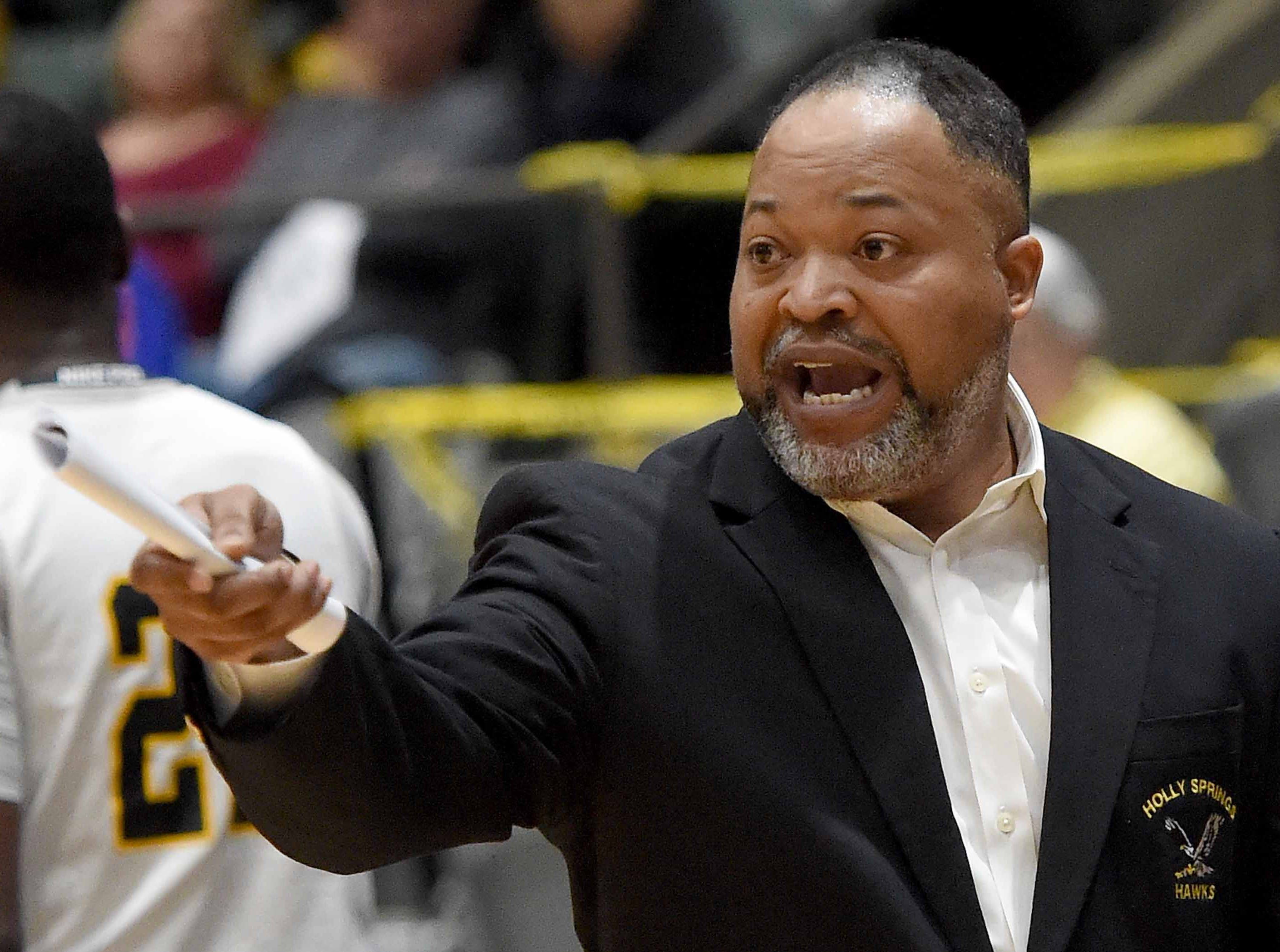 Holly Springs head coach Sylvester Kilgore Jr. calls out to his defense in the finals of the MHSAA C Spire State Basketball Championships at the Mississippi Coliseum in Jackson, Miss., on Saturday, March 9, 2019.