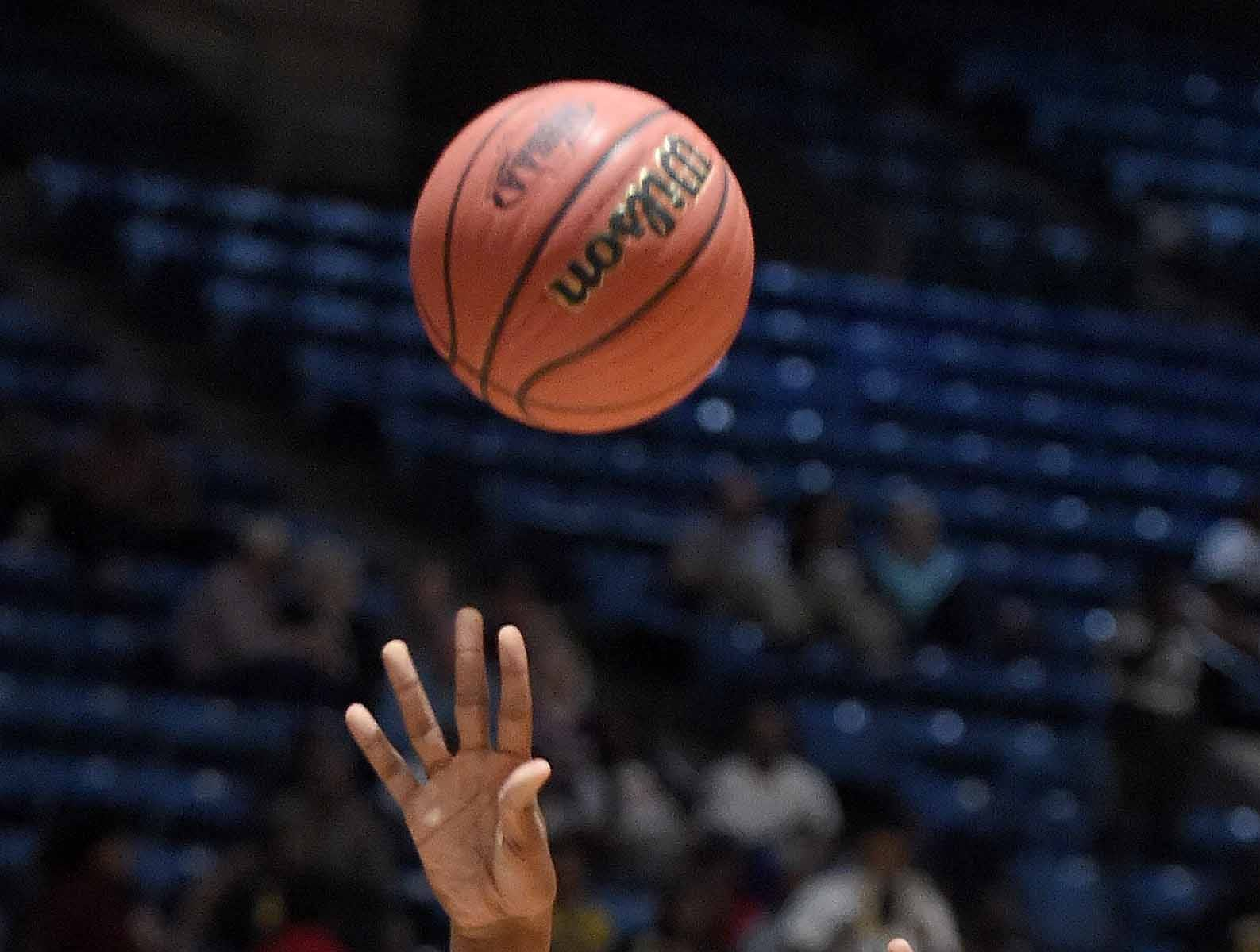 Holly Springs' Derek Fountain (20) shoots against Velma Jackson in the finals of the MHSAA C Spire State Basketball Championships at the Mississippi Coliseum in Jackson, Miss., on Saturday, March 9, 2019.
