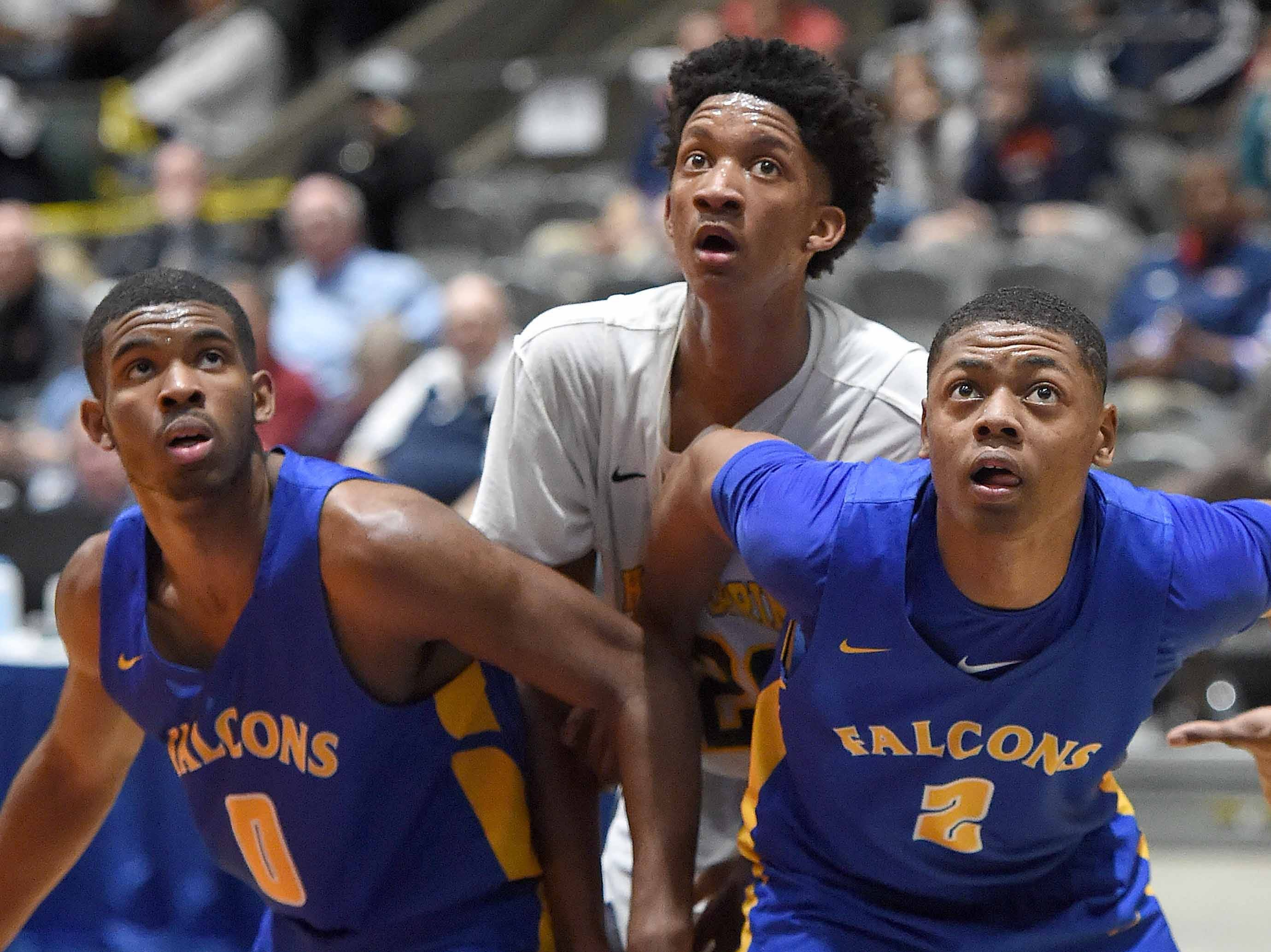 Velma Jackson's Joshua Lee (0) and Jordan Harvey (2) box out Holly Springs' Derke Fountain for a rebound in the finals of the MHSAA C Spire State Basketball Championships at the Mississippi Coliseum in Jackson, Miss., on Saturday, March 9, 2019.