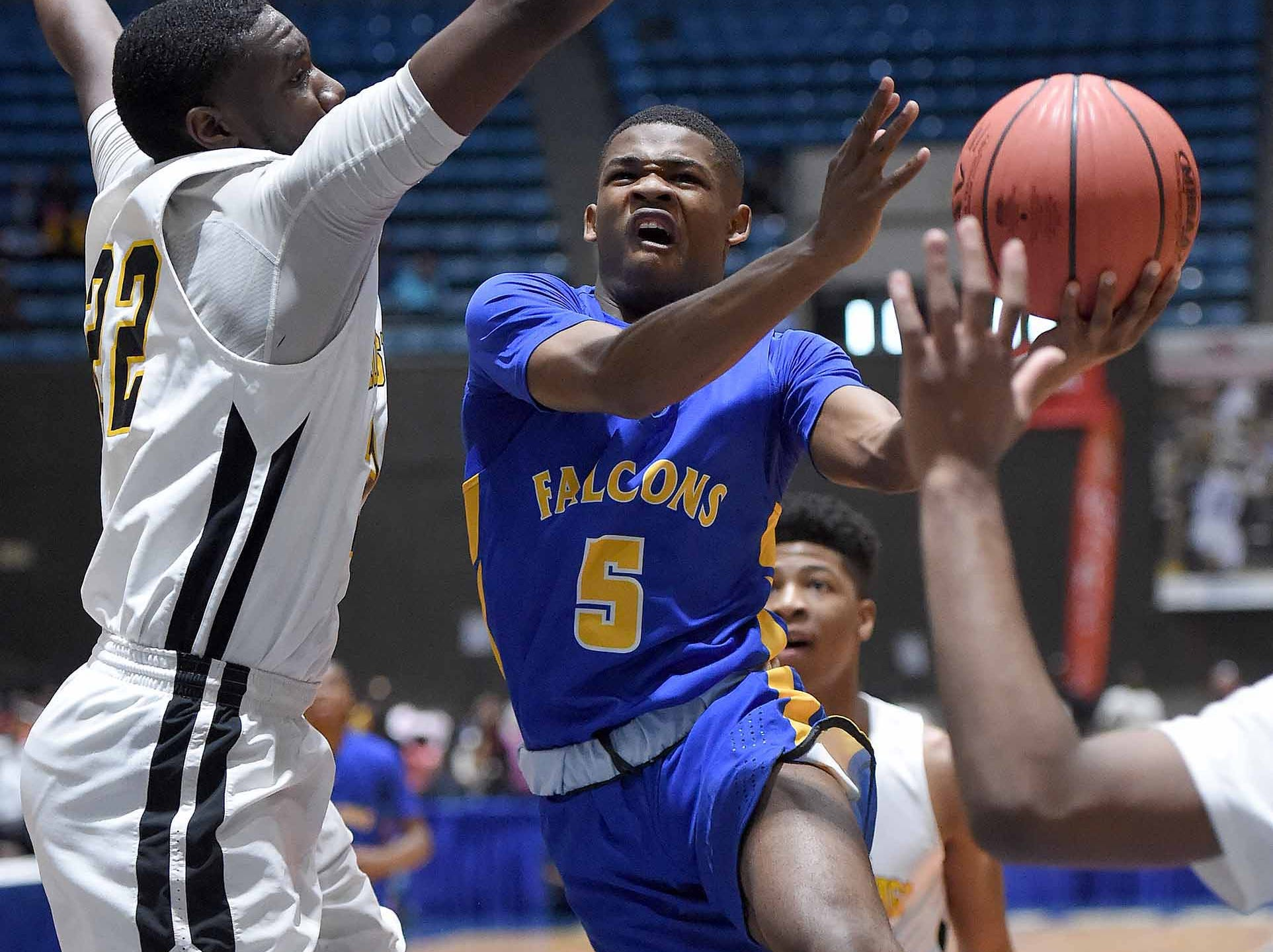 Velma Jackson's Carlton Beamon (5) drives the lane against Holly Springs in the finals of the MHSAA C Spire State Basketball Championships at the Mississippi Coliseum in Jackson, Miss., on Saturday, March 9, 2019.