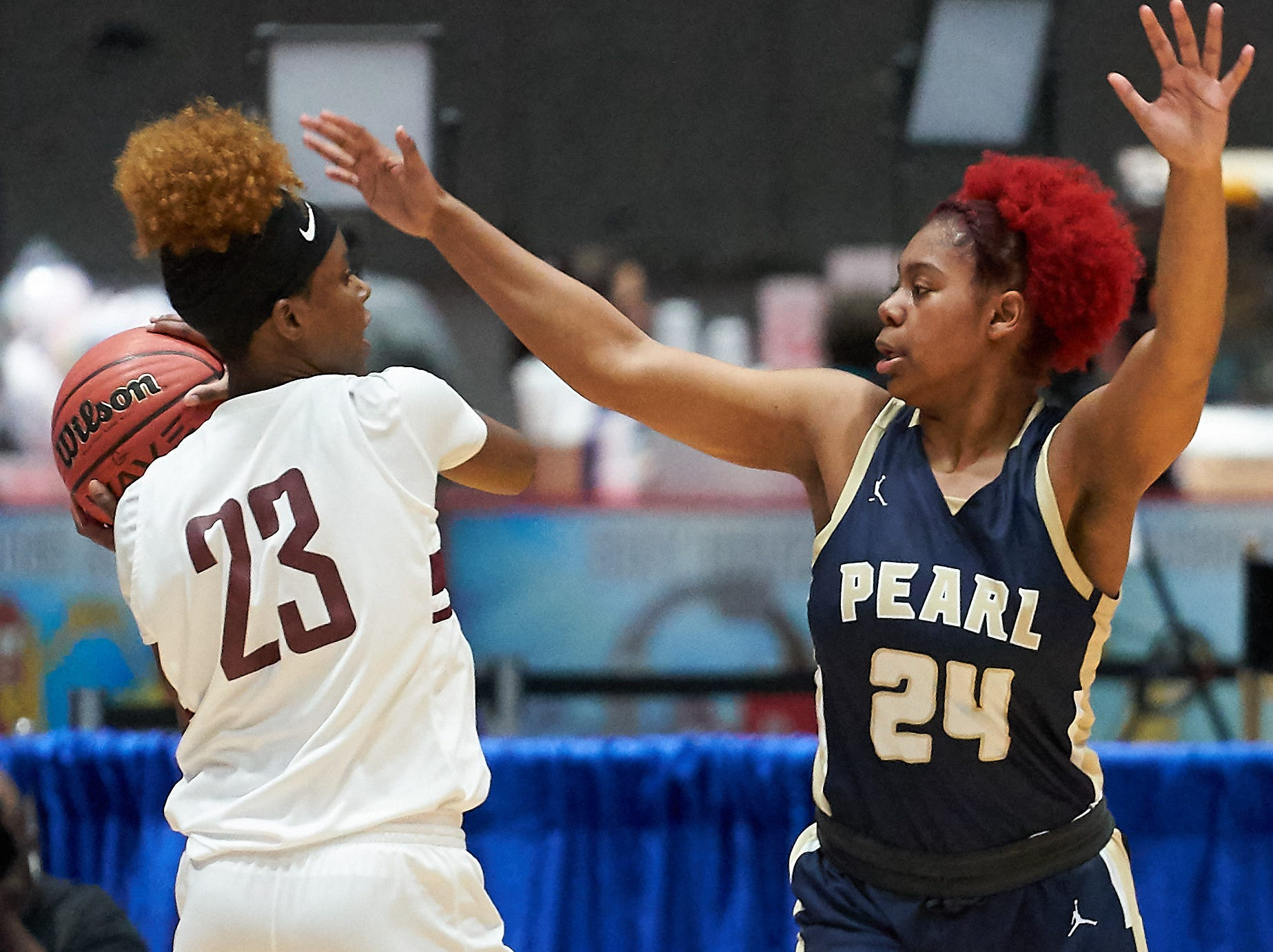Pearl's Jade Miles (24) defends against Terry's (23) Kayla Fisher (23) during the MHSAA 6A Girls Basketball Championship Finals held at the Mississippi Coliseum in Jackson, MS, Saturday March 9th, 2019.(Bob Smith)