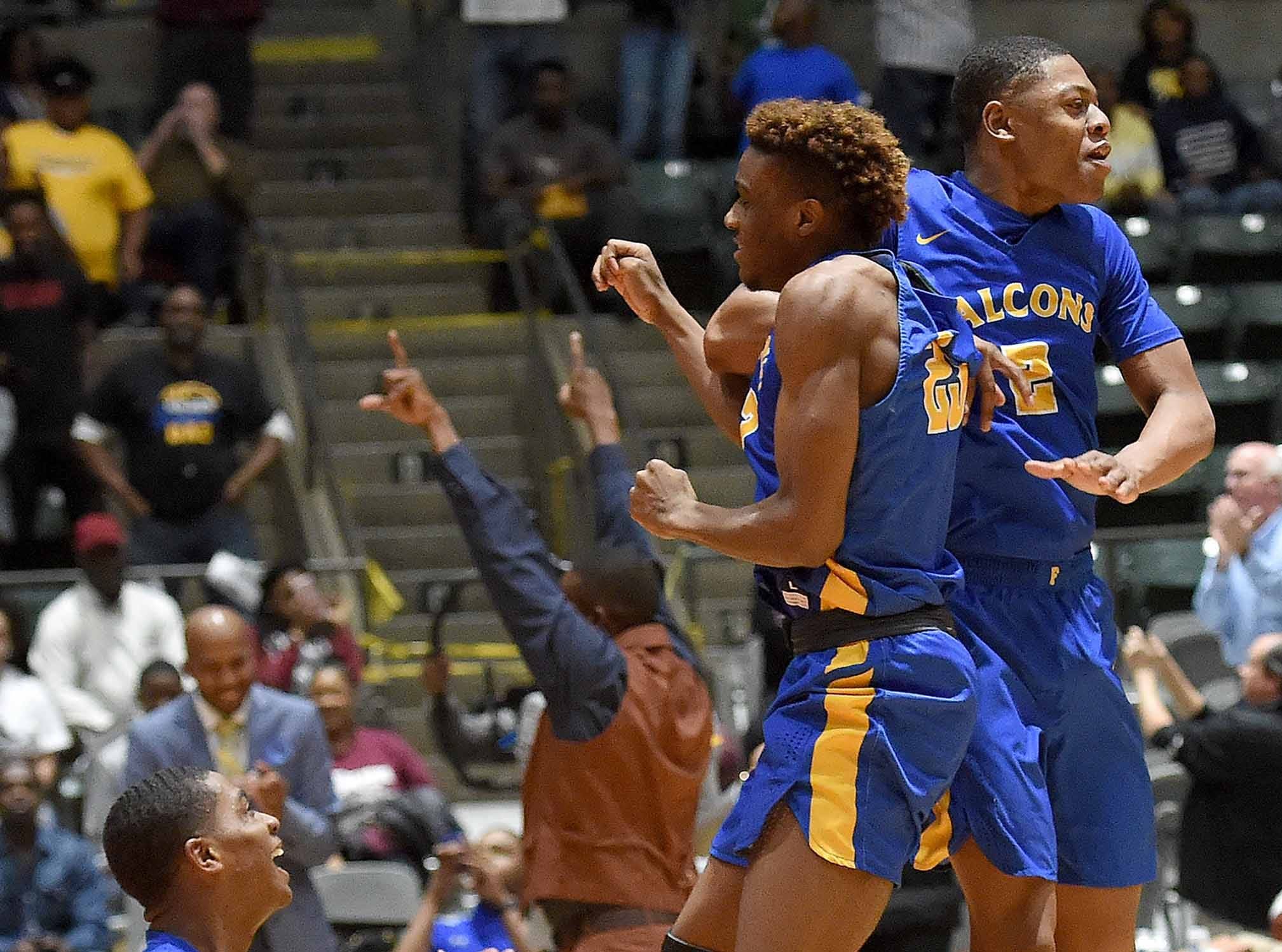 The Velma Jackson Falcons start to celebrate as time expires in the win over  Holly Springs in the finals of the MHSAA C Spire State Basketball Championships at the Mississippi Coliseum in Jackson, Miss., on Saturday, March 9, 2019.