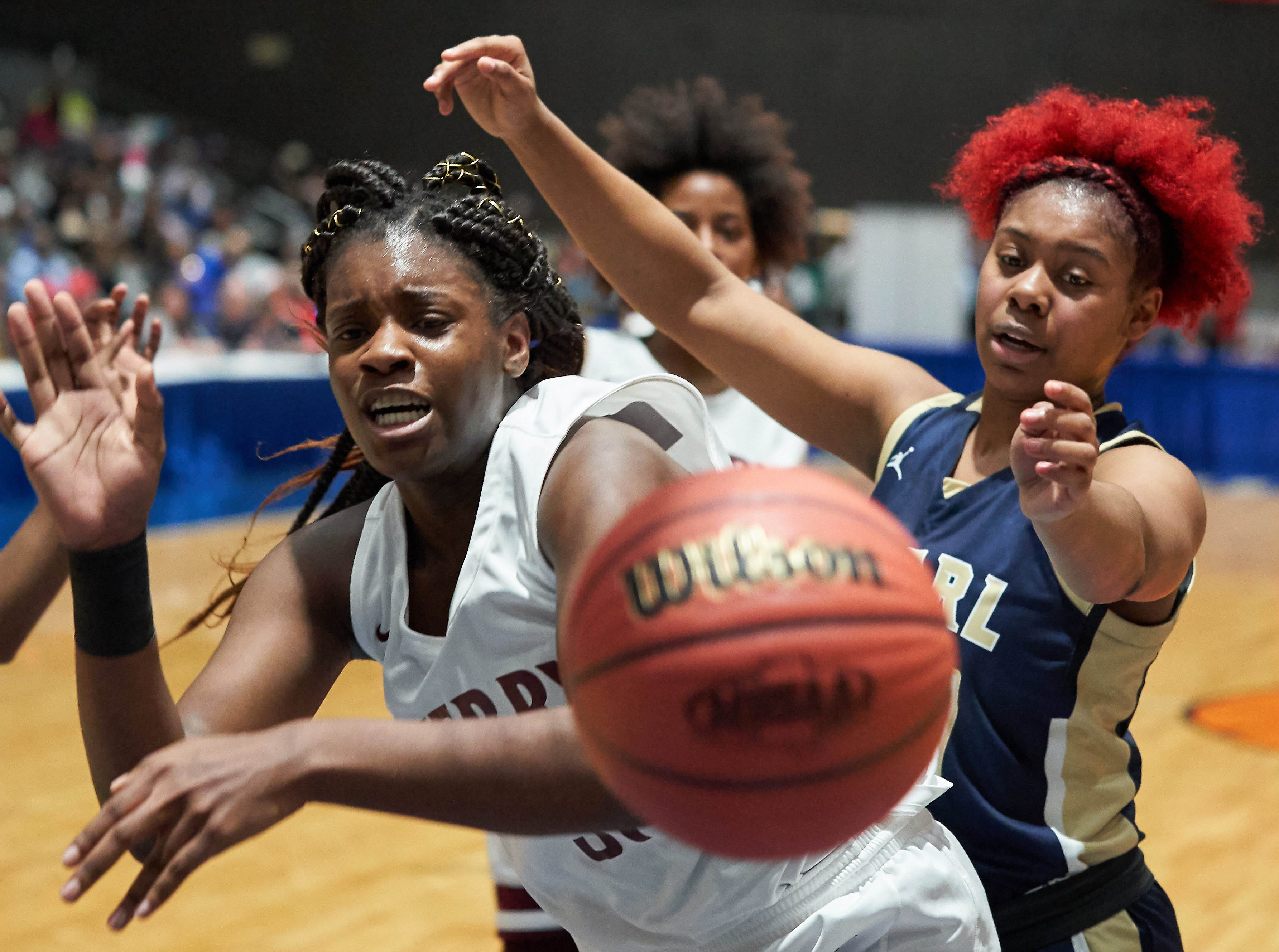 Pearl's Jade Miles (24) and Terry's Bryanna Taylor (31) battle for a loose ball during the MHSAA 6A Girls Basketball Championship Finals held at the Mississippi Coliseum in Jackson, MS, Saturday March 9th, 2019.(Bob Smith)
