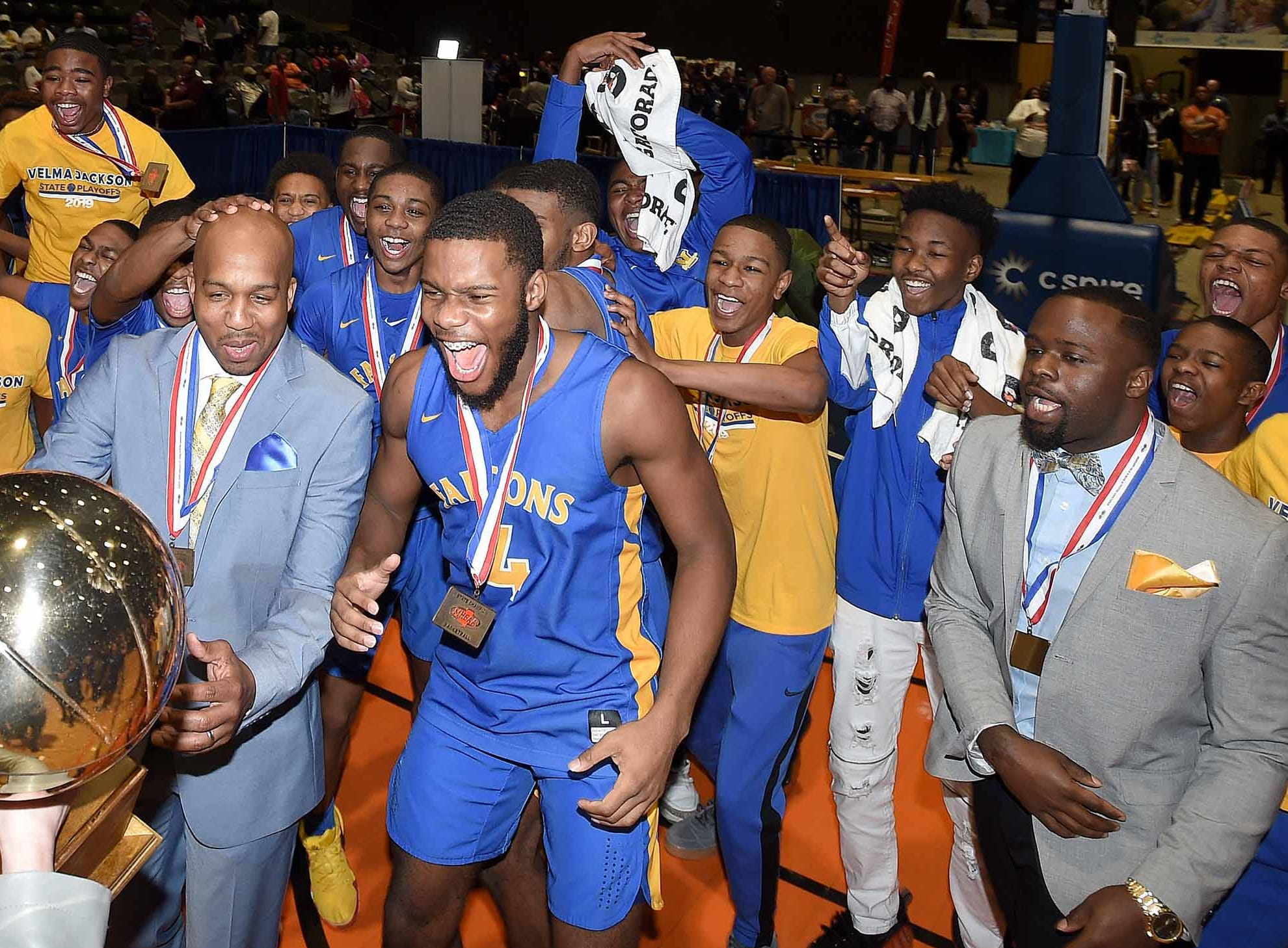 The Velma Jackson Falcons receive the Class 3A trophy after beating Holly Springs in the finals of the MHSAA C Spire State Basketball Championships at the Mississippi Coliseum in Jackson, Miss., on Saturday, March 9, 2019.