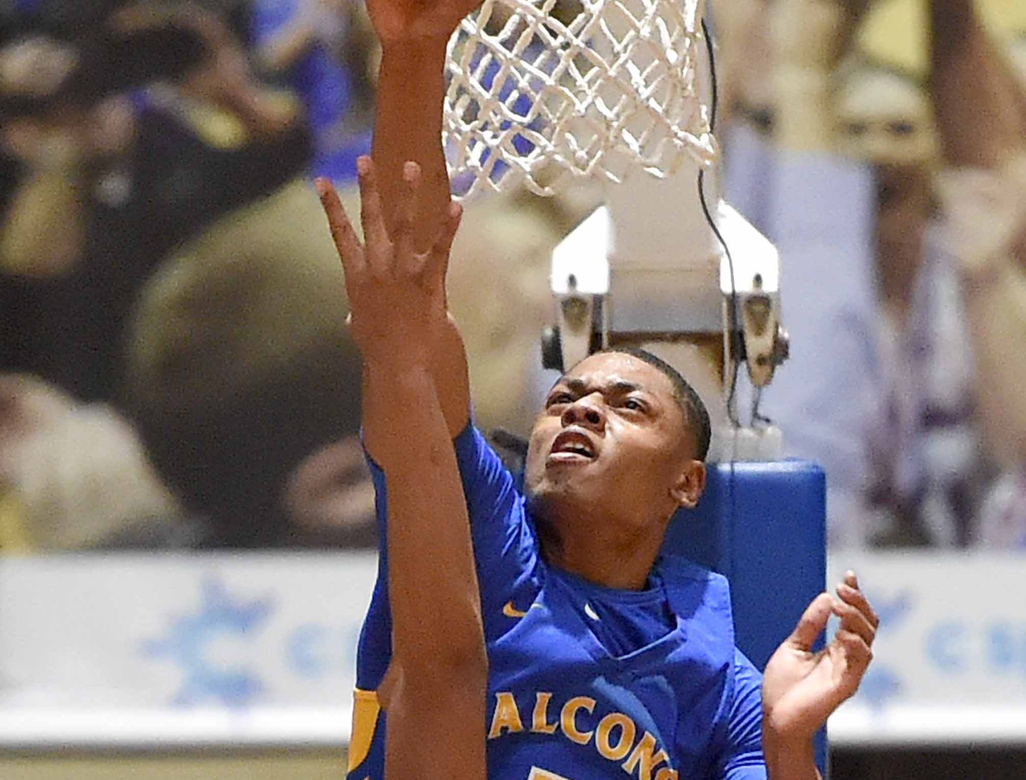 Velma Jackson's Jordan Harvey (2) blocks the shot by  Holly Springs' Dylan King in the finals of the MHSAA C Spire State Basketball Championships at the Mississippi Coliseum in Jackson, Miss., on Saturday, March 9, 2019.