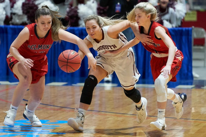 Kossuth's Madison Starling (20) tries to make a steal from Belmont's Lacie Walker (12) and Abby Kuykendall (1) during the MHSAA 3A Girls Basketball Championship Finals held at the Mississippi Coliseum in Jackson, MS, Saturday March 9th, 2019.(Bob Smith)