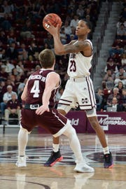 Mar 9, 2019; Starkville, MS, USA; Mississippi State Bulldogs guard Tyson Carter (23) handles the ball as Texas A&M Aggies guard Mark French (4) defends during the second half at Humphrey Coliseum. Mandatory Credit: Matt Bush-USA TODAY Sports