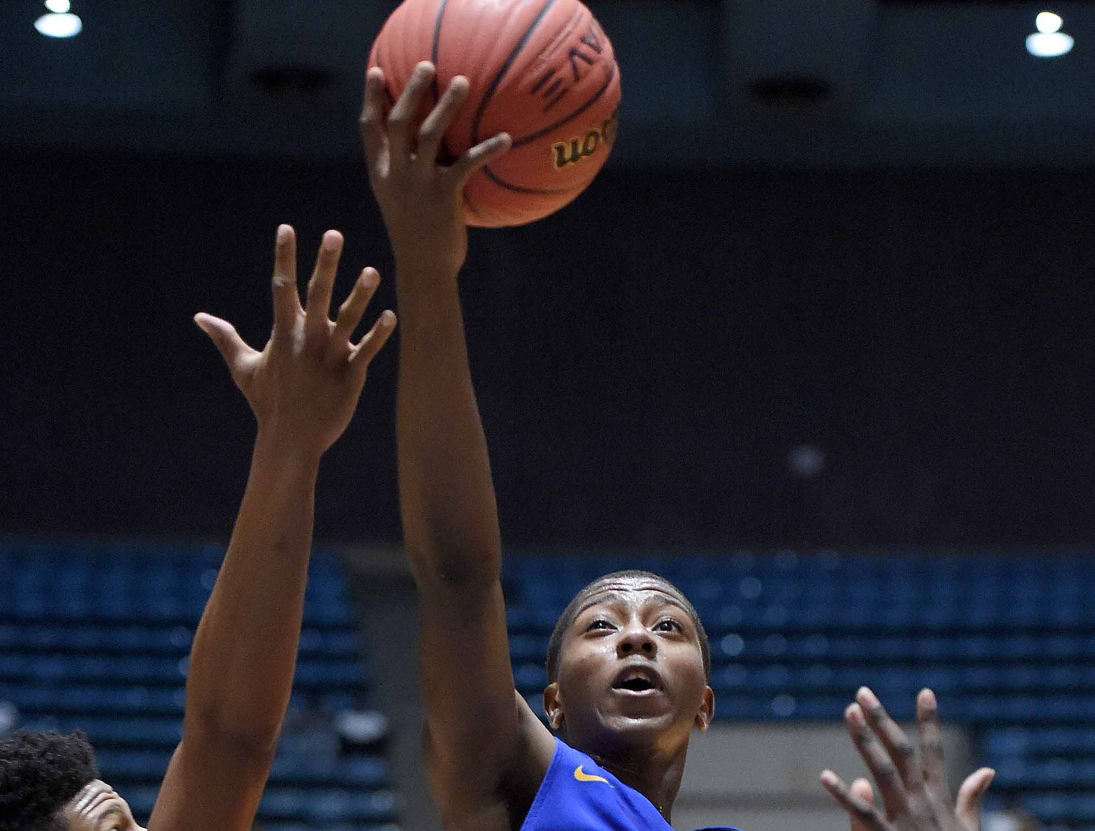 Velma Jackson's Levaeon Griffin (3) drives the lane against Holly Springs in the finals of the MHSAA C Spire State Basketball Championships at the Mississippi Coliseum in Jackson, Miss., on Saturday, March 9, 2019.