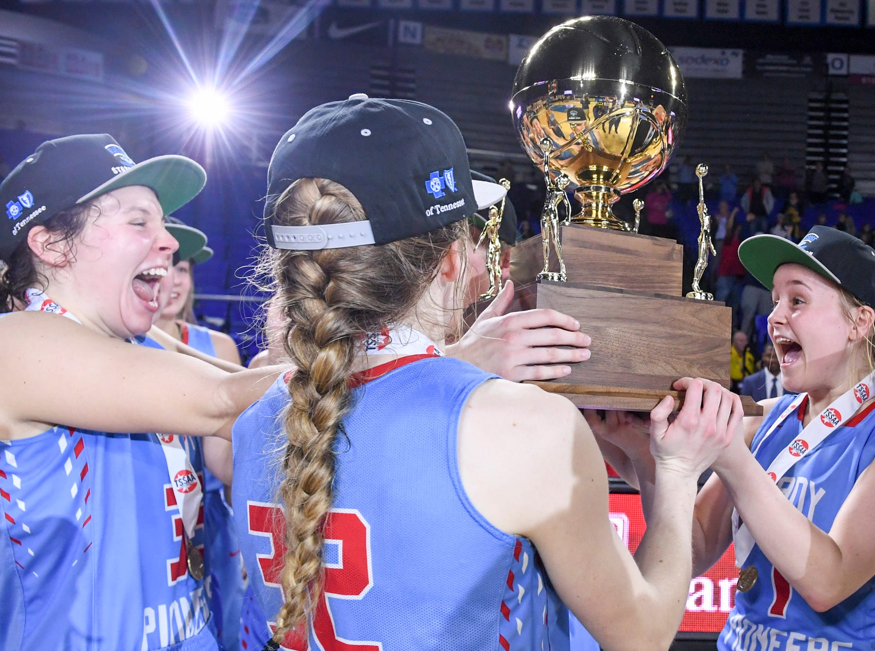 Gibson County's Ashton Lannom (1) smiles with Gibson County's Hannah Ball (35) and Gibson County's KJ White (32) as they raise up the championship trophy at the end of their Class A championship game, Saturday, March 9, 2019, in Murfreesboro. Gibson County defeated Loretto, 50-42 to become the 2019 Class A Champions.