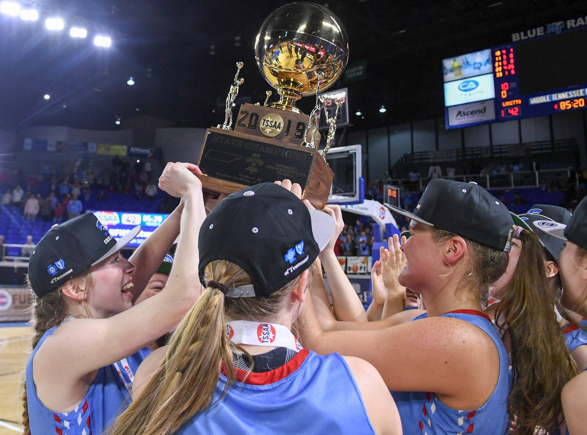 The Lady Pioneers of Gibson County High School hold up their championship trophy at the end of their Class A championship game, Saturday, March 9, 2019, in Murfreesboro. Gibson County defeated Loretto, 50-42 to become the 2019 Class A Champions.