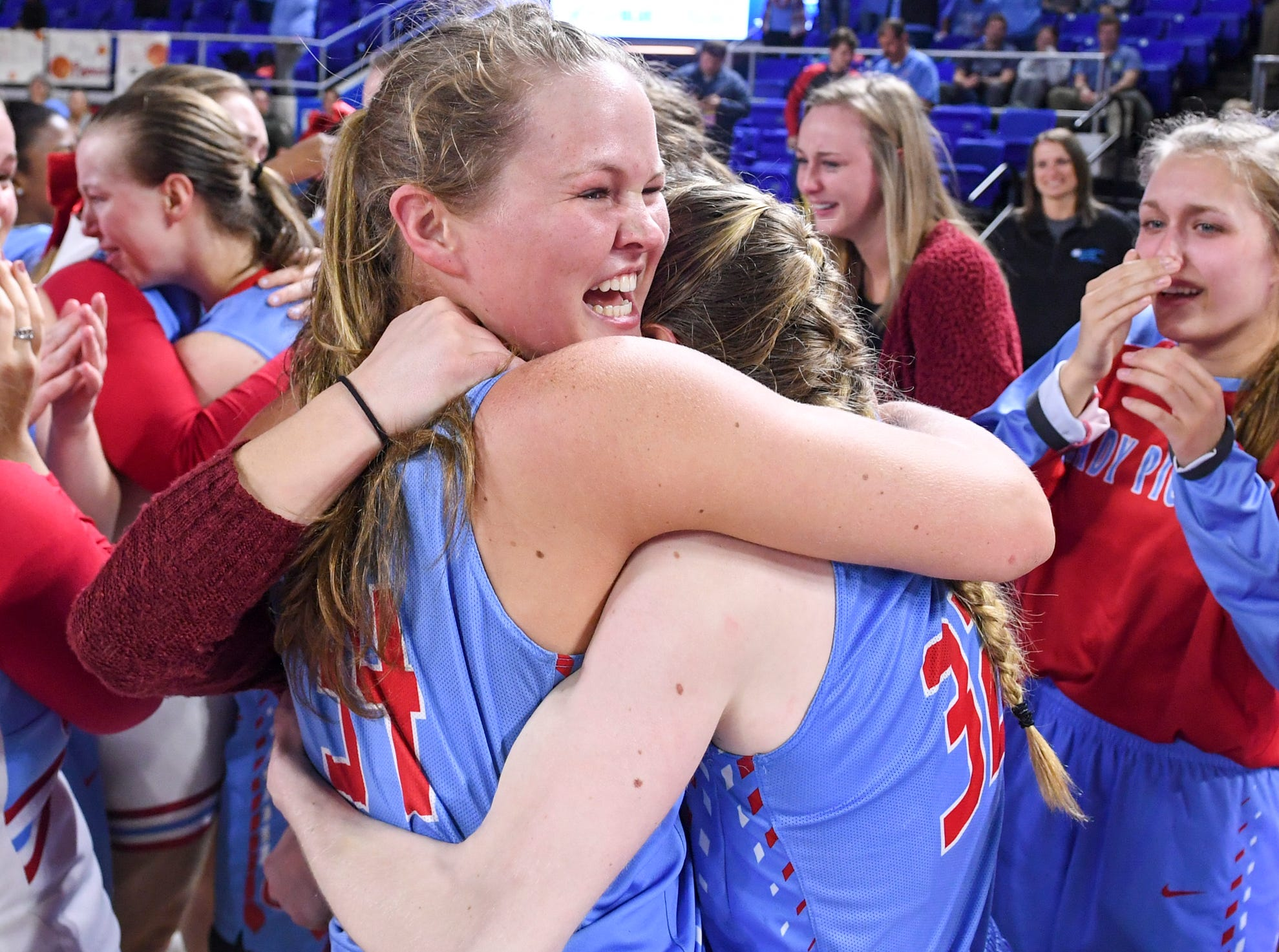 Gibson County's McKinley Burkett (34) smiles while hugging Gibson County's KJ White (32) at the end of their Class A championship game, Saturday, March 9, 2019, in Murfreesboro. Gibson County defeated Loretto, 50-42 to become the 2019 Class A Champions.