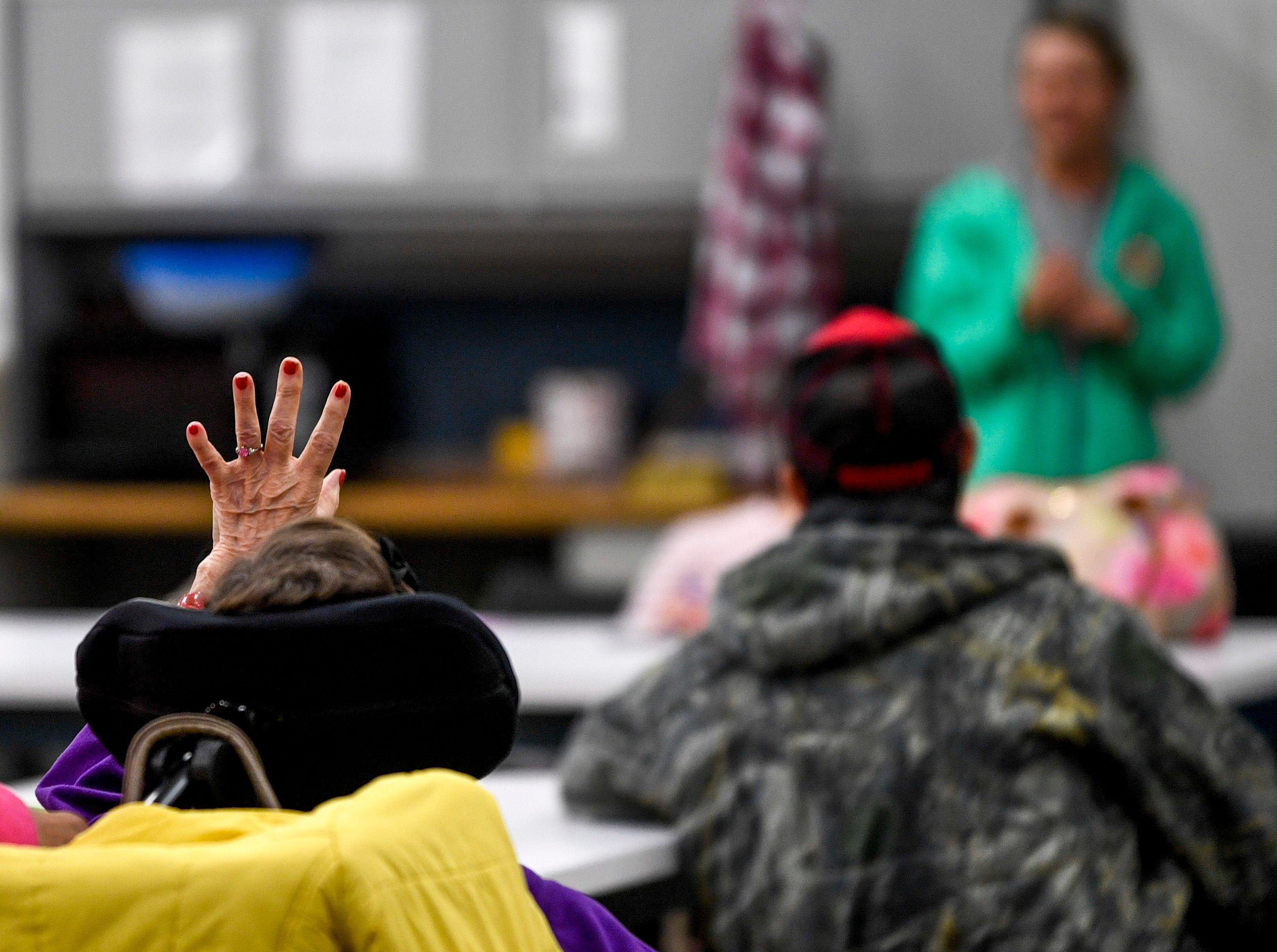 Linda Davis raises her hand to answer a question during class at McNairy Developmental Services in Selmer, Tenn., on Thursday, Feb. 21, 2019.