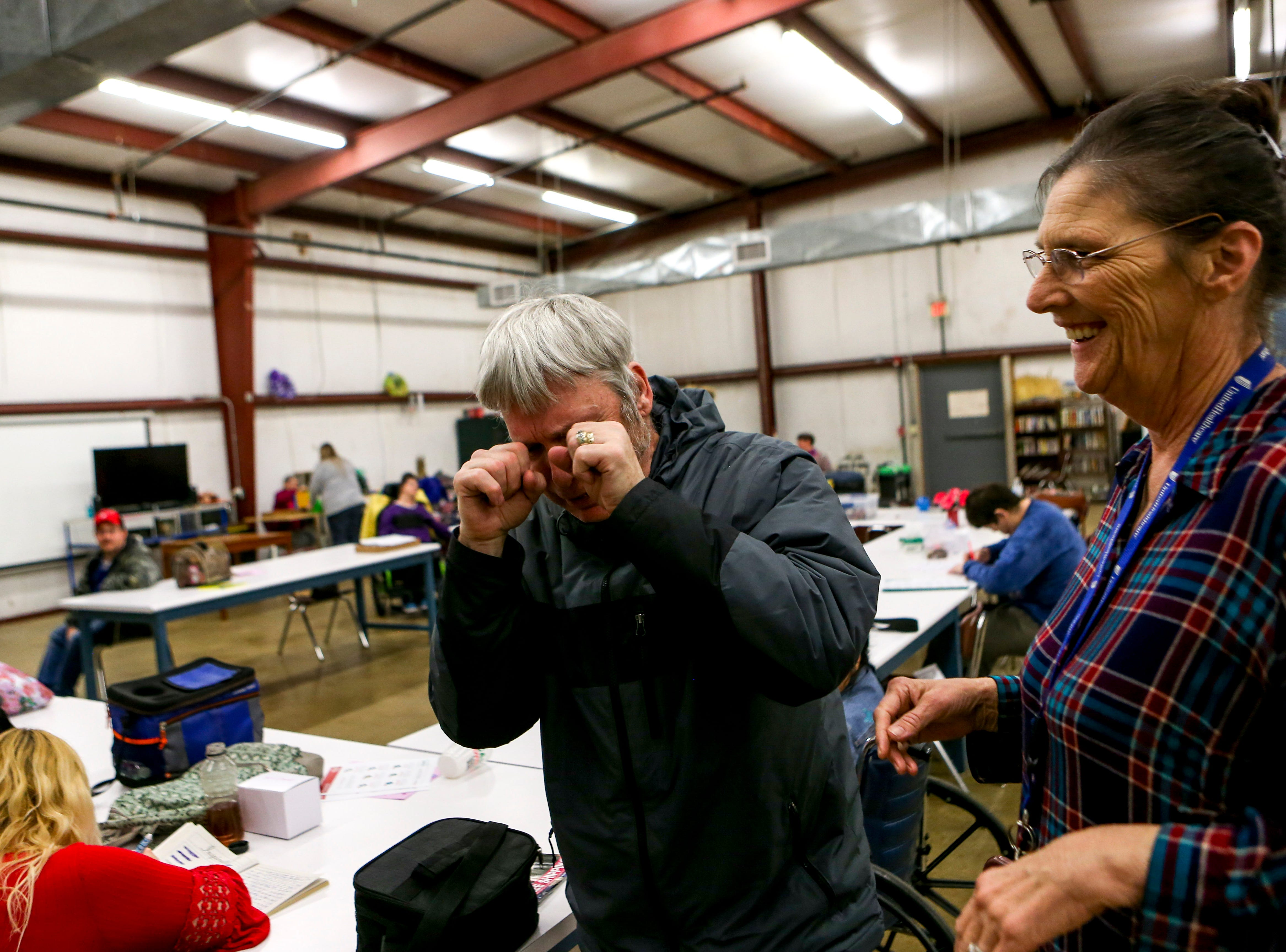 Tommy Walker jokes about how sad he is with Elaine Gladish after classes at McNairy Developmental Services in Selmer, Tenn., on Thursday, Feb. 21, 2019.