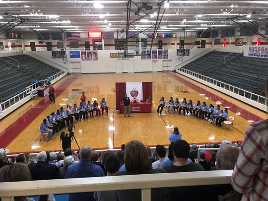 The crowd listens in Gibson County's gym as Gibson County Special Schools District Superintendent Eddie Pruett congratulates the players.