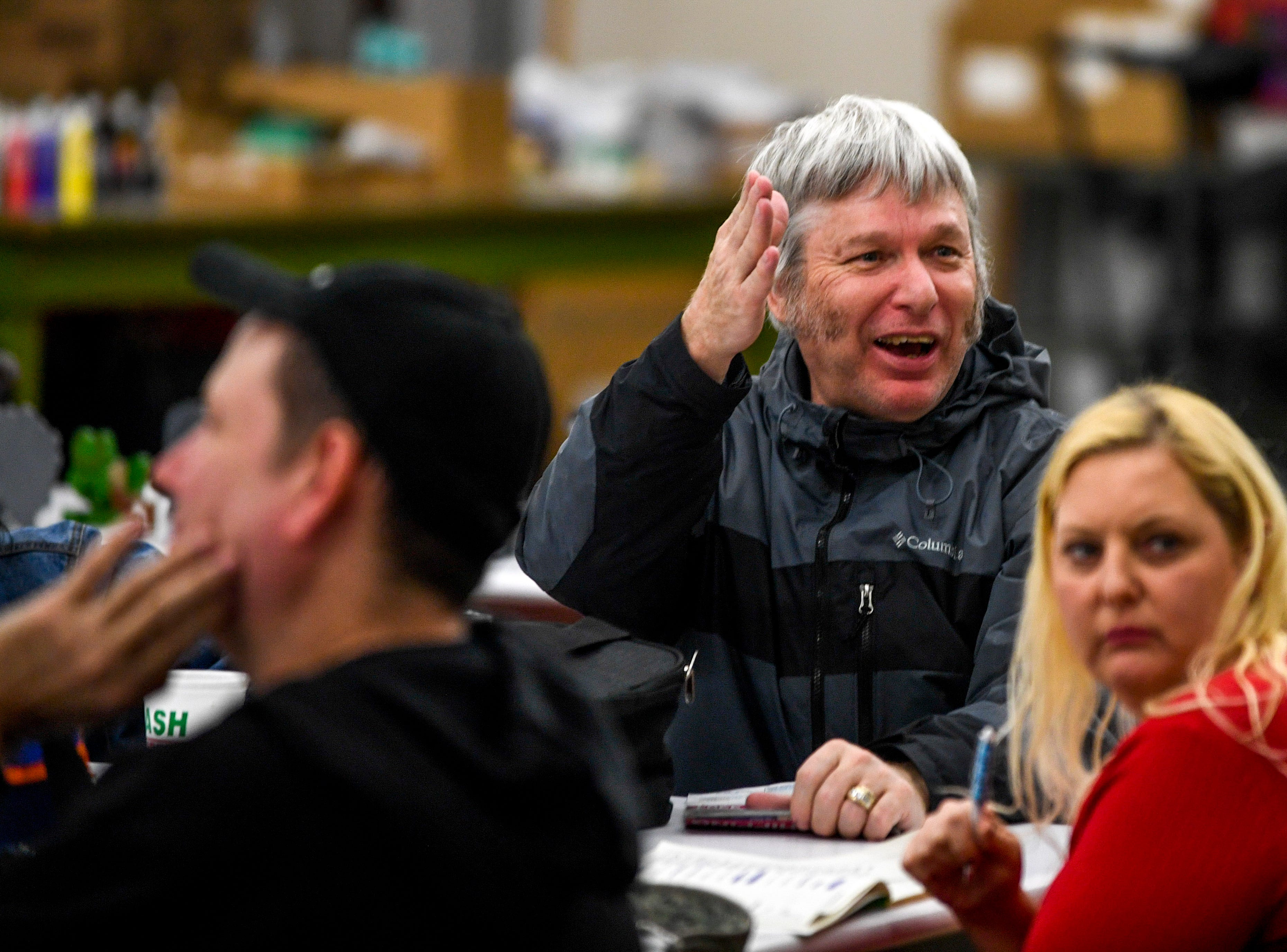 Tommy Walker, the class Elvis impersonator, raises his hand to argue a point during class at McNairy Developmental Services in Selmer, Tenn., on Thursday, Feb. 21, 2019.