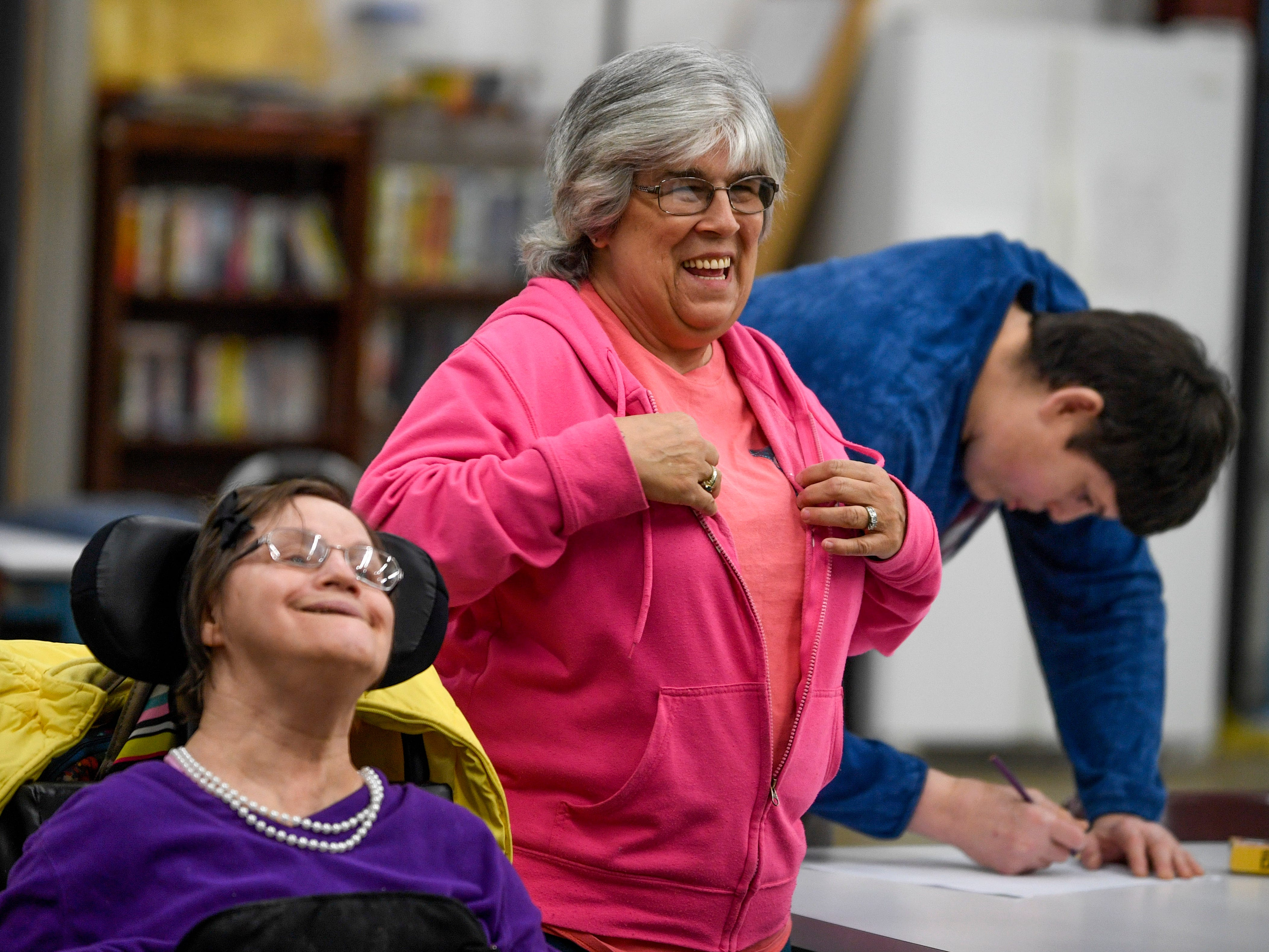 Denise Murphy laughs with students after Linda Davis, left, answers a question during a class at McNairy Developmental Services in Selmer, Tenn., on Thursday, Feb. 21, 2019.