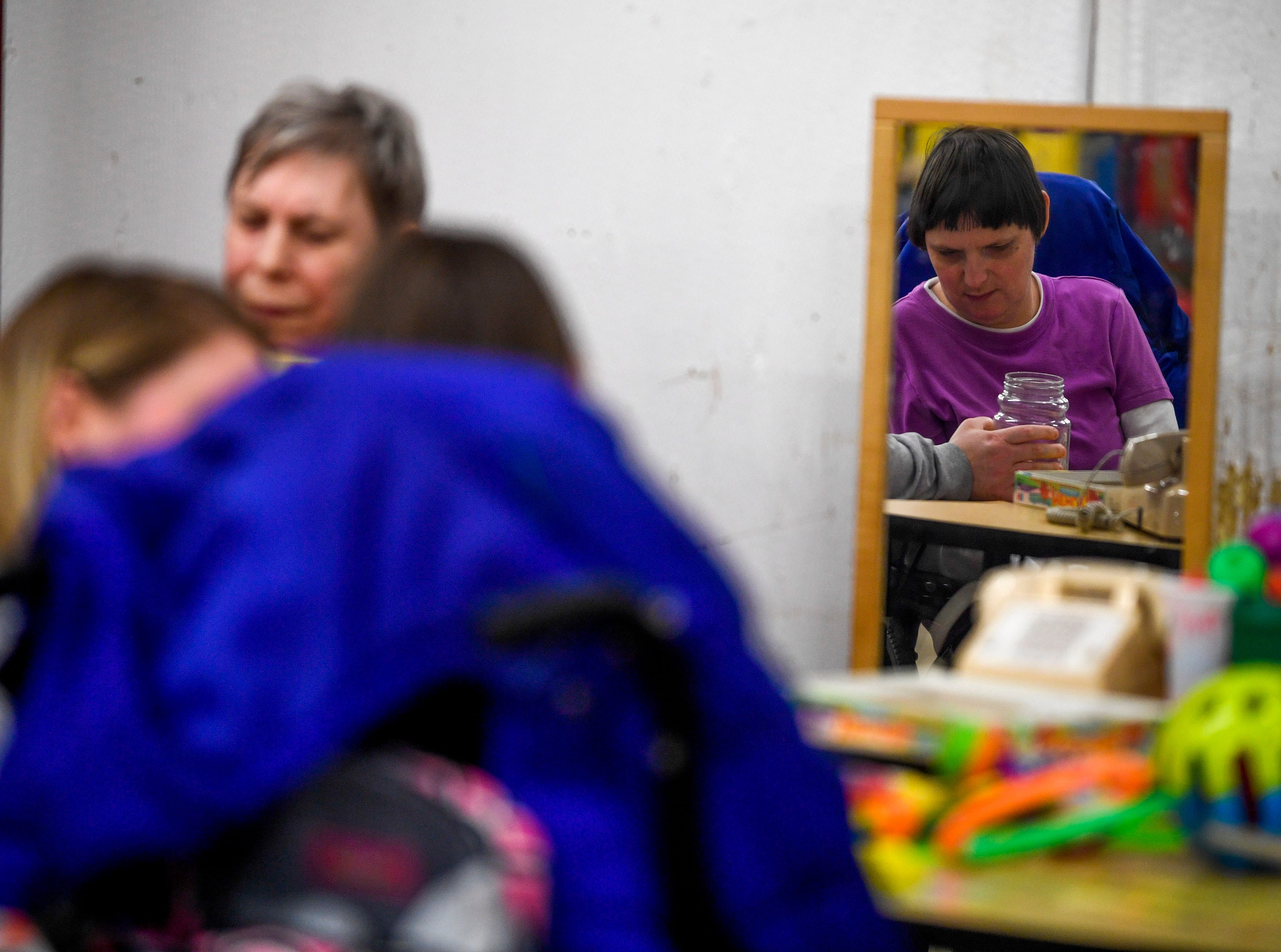 Angie Kyle takes lessons and listens to a teacher during classes at McNairy Developmental Services in Selmer, Tenn., on Thursday, Feb. 21, 2019.