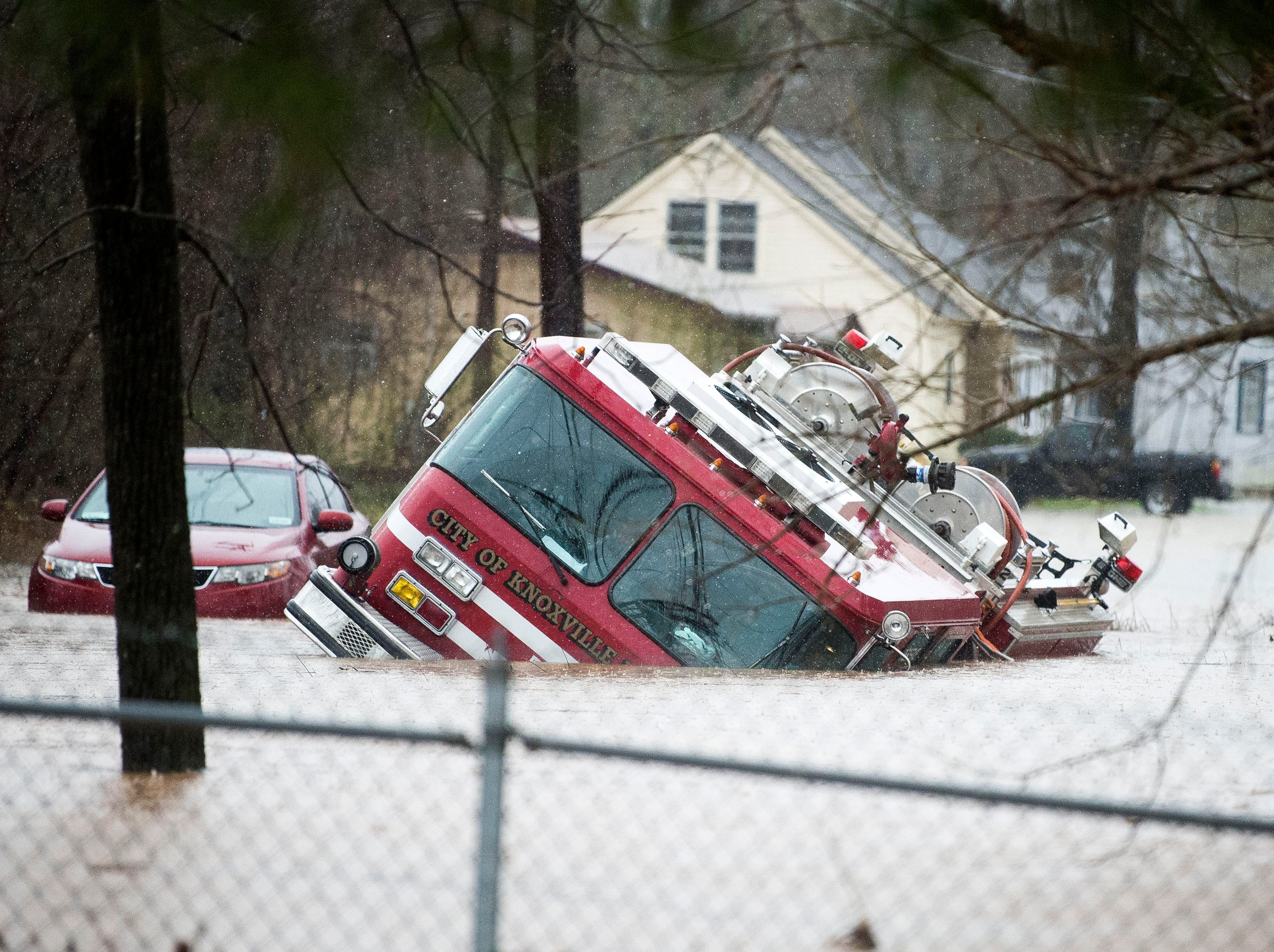 A Knoxville firetruck is overtaken by flood water near the Kroger in Fountain City Saturday, Feb. 23, 2019.