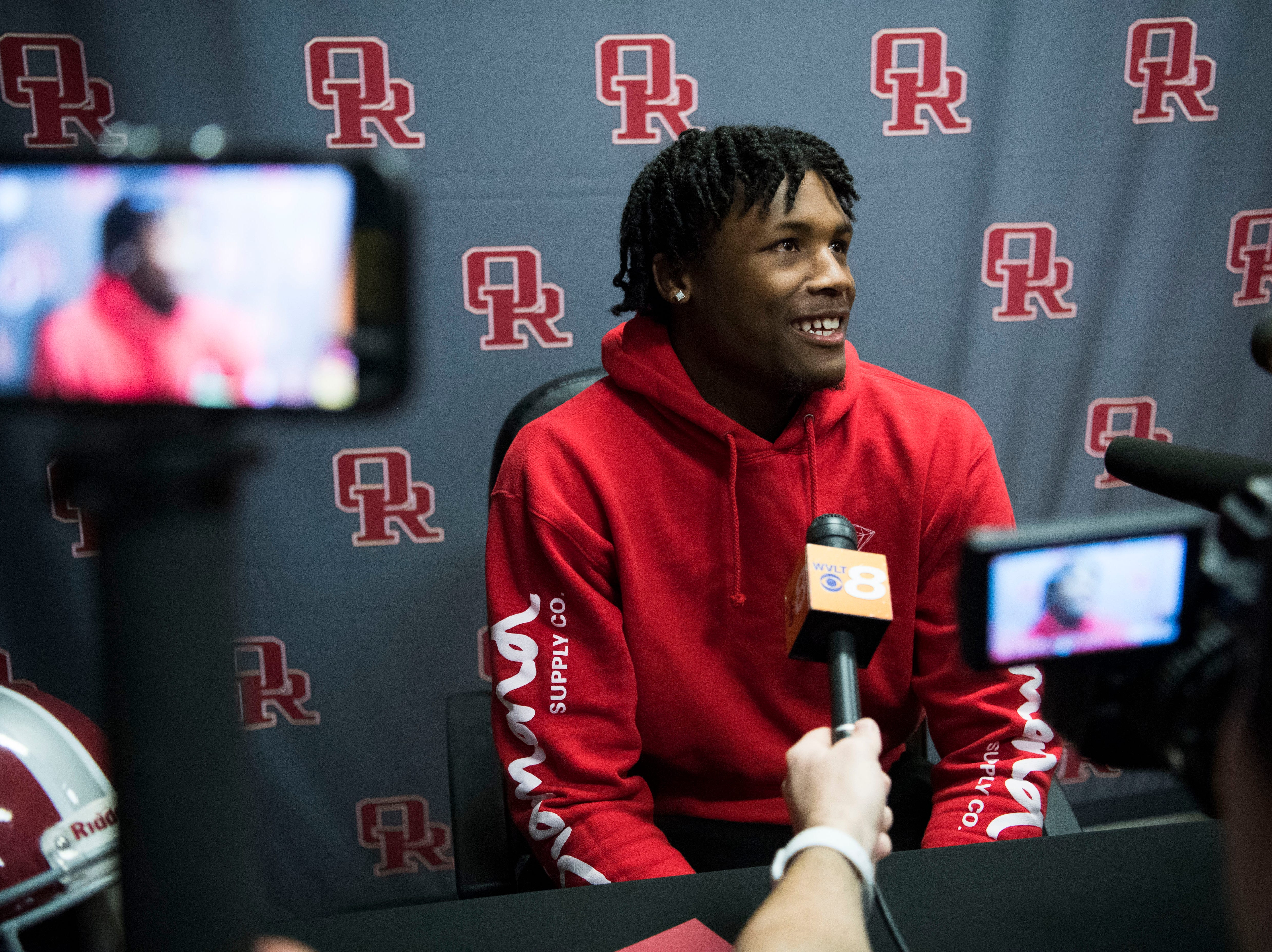 Former Oak Ridge High School athlete Tee Higgins, now a wide receiver at Clemson University, speaks to the media after his jersey was retired, during a high school basketball game between Oak Ridge and Campbell County at Oak Ridge Friday, Feb. 1, 2019.