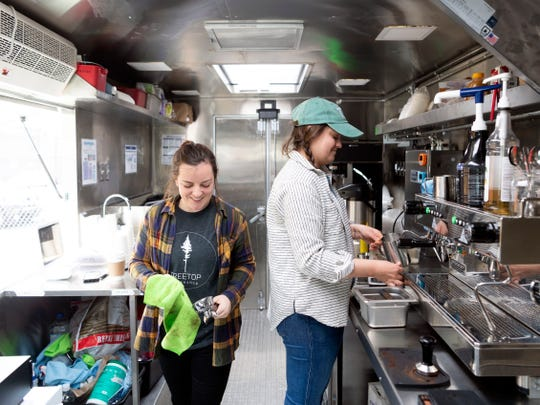Texas natives Courtney Peters, left, and Rachel Casstevens on their second day of business operating their mobile coffee shop at Central Filling Station on Sunday, March 10, 2019. The Texas natives chose Knoxville to start their business over Asheville, Chattanooga, and Greenville, TN.