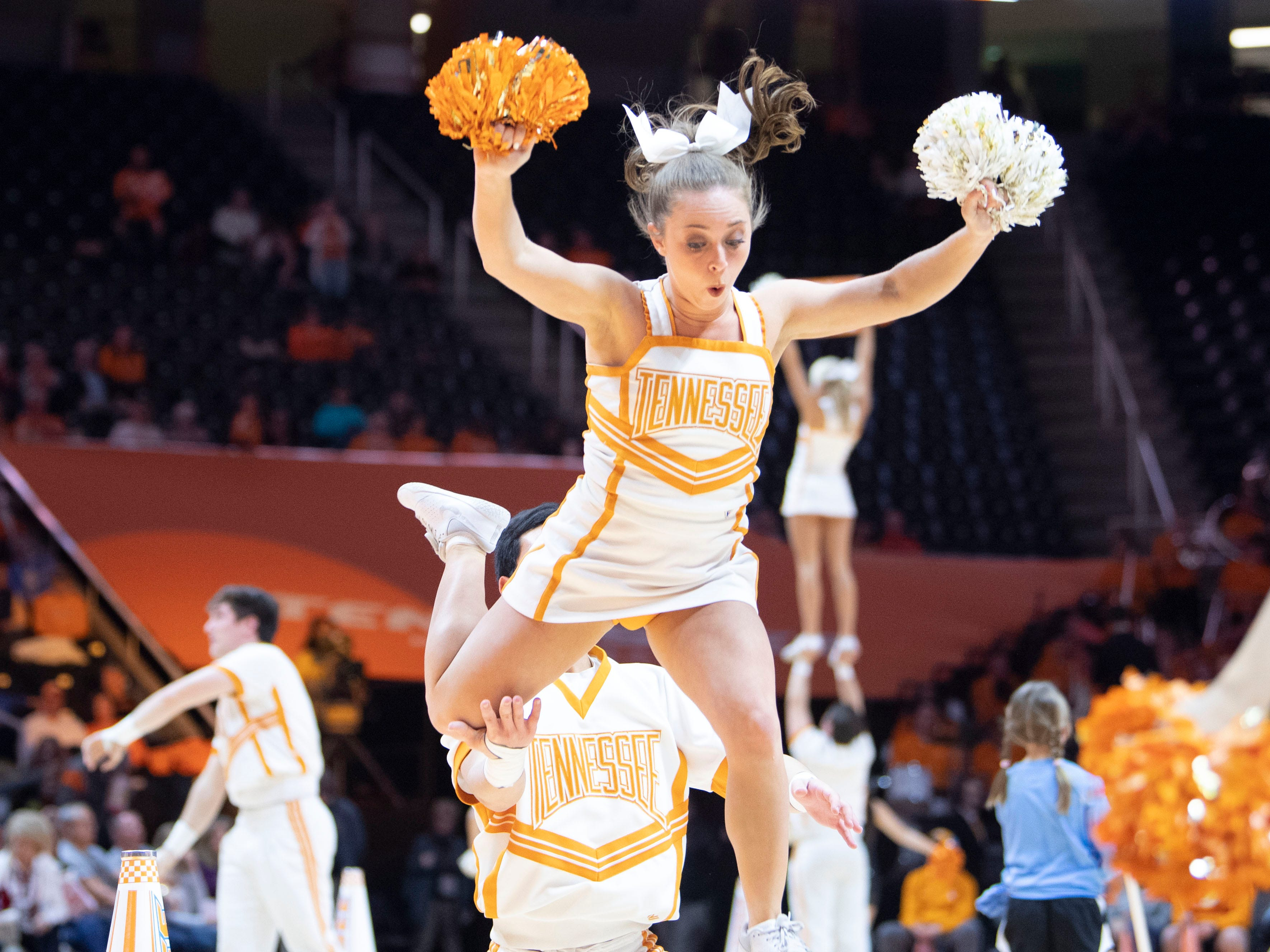 A Tennessee cheerleader loses her balance while performing at the Lady Vols and Auburn game on Thursday, February 14, 2019.
