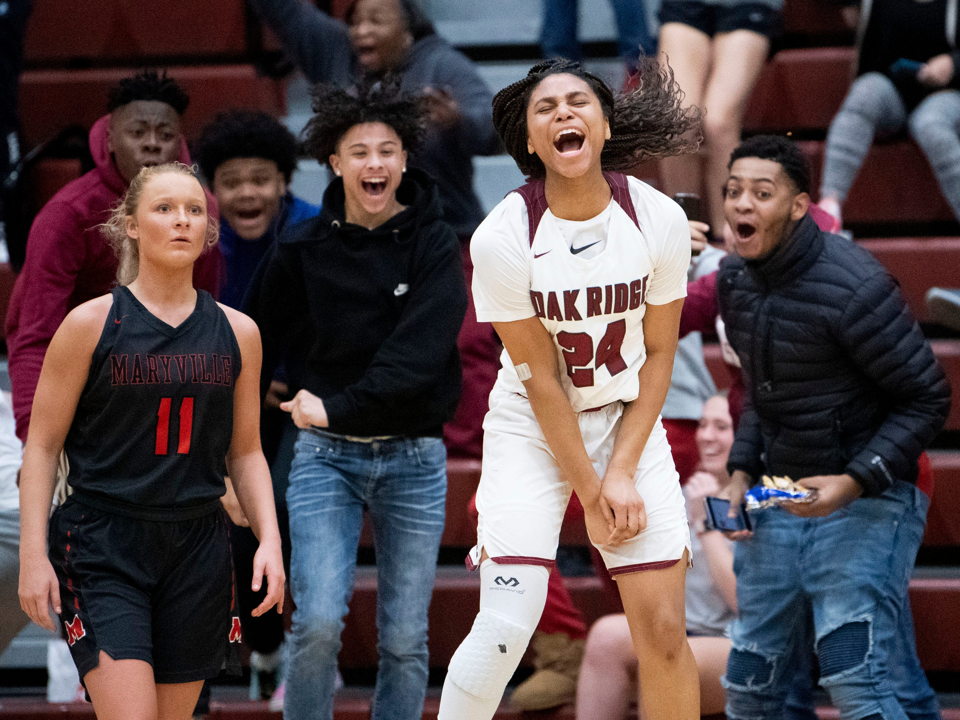 Oak Ridge's Jada Guinn (24) and fans erupt in celebration as her 3-point buzzer beater secures a 53-50 win against Maryville in the Region 2-AAA tournament on Wednesday, February 27, 2019.