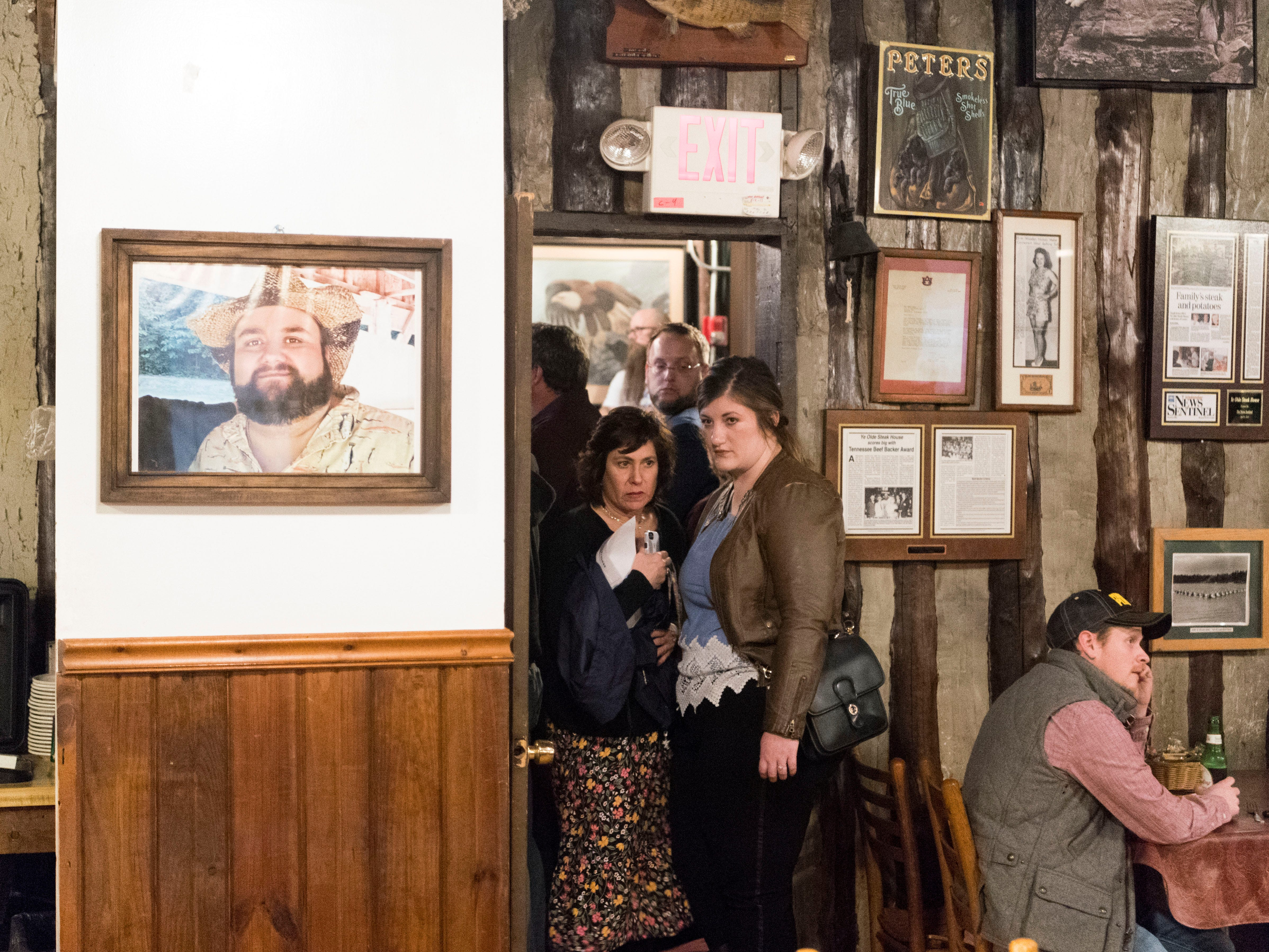 People outside the doorway of a packed dining room at Ye Olde Steak House on Monday, February 4, 2019 during a public question and answer meeting about rezoning changes for the proposed theme park, Ancient Lore Resort, in South Knox County.