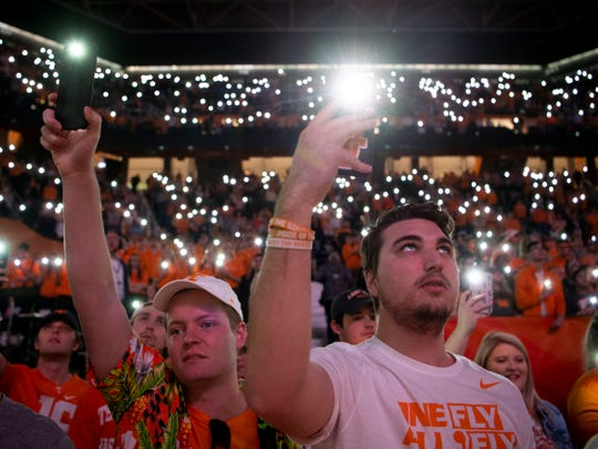 Tennessee basketball fans and students Matt Sizemore, left, and Student Section president Shea Payne use the Hoops Hype app as the team is introduced for the game against South Carolina on Wednesday, February 13, 2019.