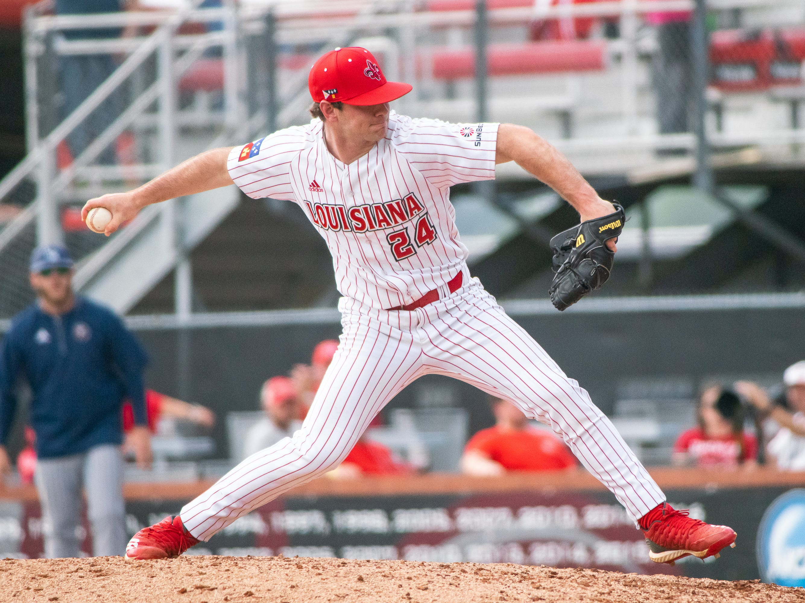 UL's Caleb Armstrong pitches from the mound as the Ragin' Cajuns take on the Loyola Marymount Lions at M.L. Tigue Moore Field on March 10, 2019.