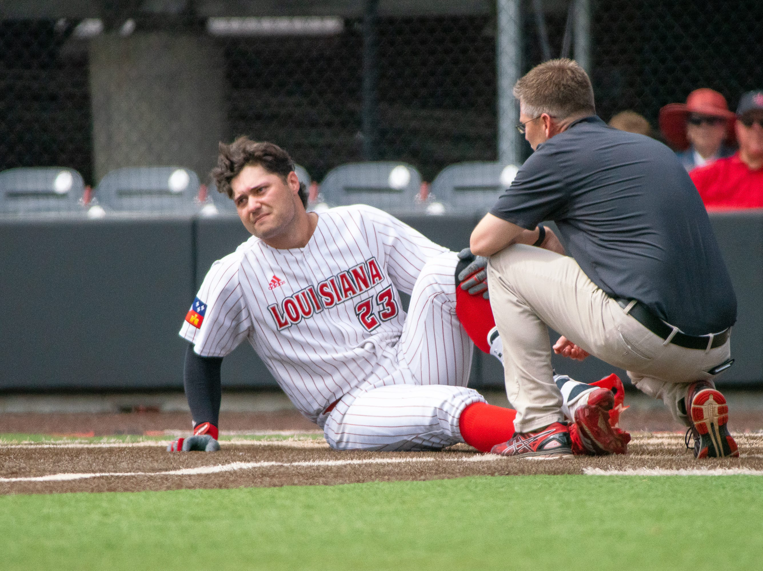UL's Handsome Monica lays down hurt after getting hit by the pitch as the Ragin' Cajuns take on the Loyola Marymount Lions at M.L. Tigue Moore Field on March 10, 2019.