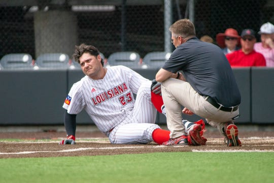 UL's Handsome Monica is checked out after getting hit by a pitch in a game against Loyola Marymount earlier this season.