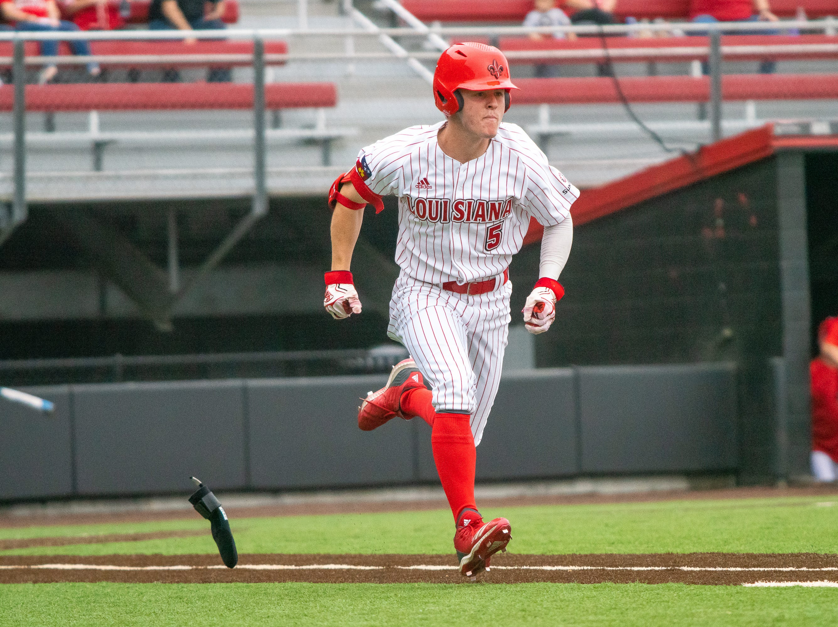 UL's Hayden Cantrelle sprints to first base as the Ragin' Cajuns take on the Loyola Marymount Lions at M.L. Tigue Moore Field on March 10, 2019.