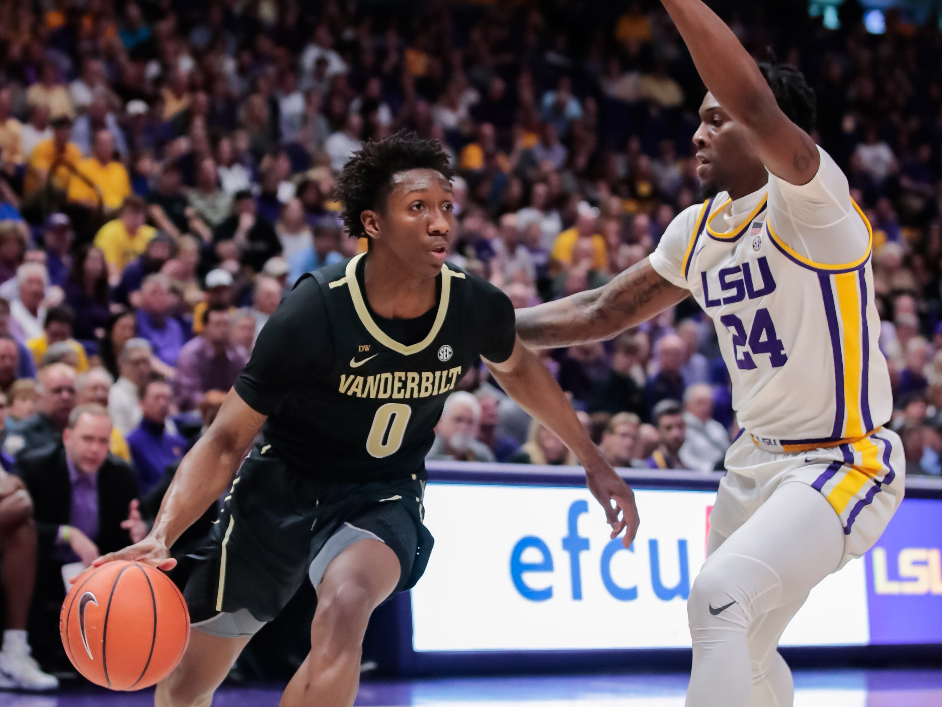 Mar 9, 2019; Baton Rouge, LA, USA; Vanderbilt Commodores guard Saben Lee (0) dribbles against LSU Tigers forward Emmitt Williams (24) in the first half at Maravich Assembly Center. Mandatory Credit: Stephen Lew-USA TODAY Sports