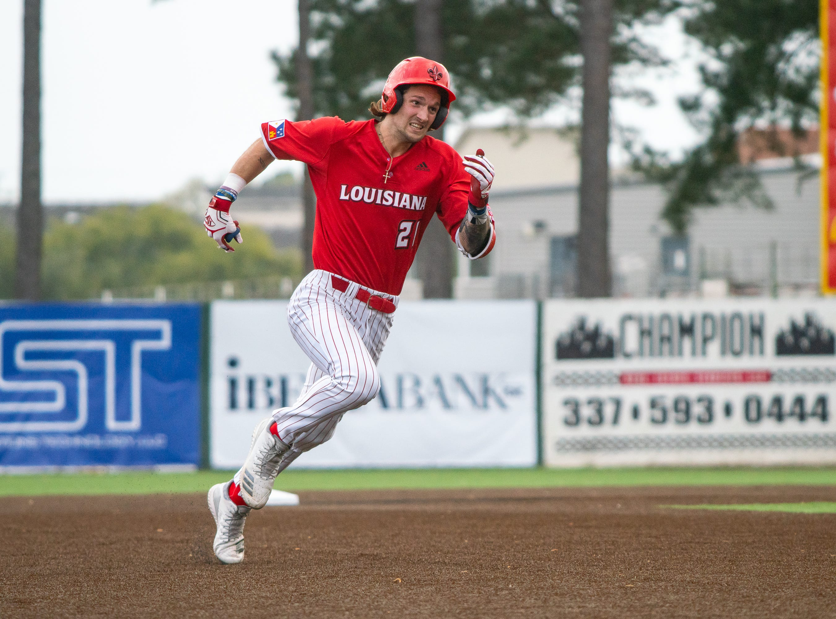 UL's Orynn Veillon sprints to third base as the Ragin' Cajuns take on the Loyola Marymount Lions at M.L. Tigue Moore Field on March 9, 2019.