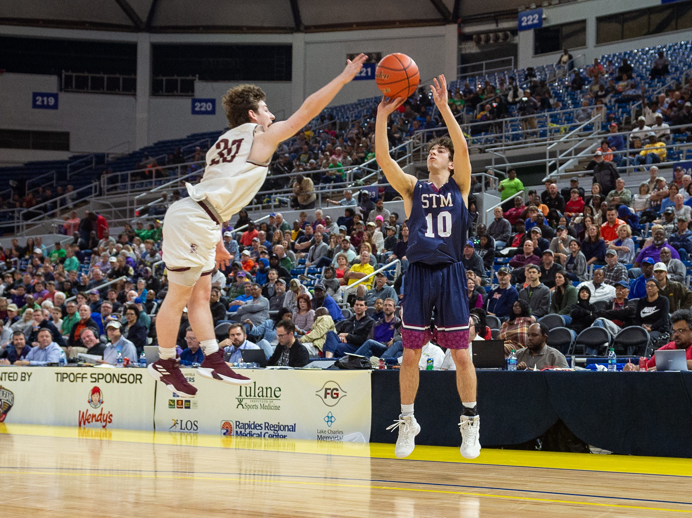 Reece Melancon shoots a three as The STM Cougars beat DeLaSalle in double overtime to win the Allstate Sugar Bowl/LHSAA Boys' Marsh Madness Div II State Championship. Saturday, March 9, 2019.