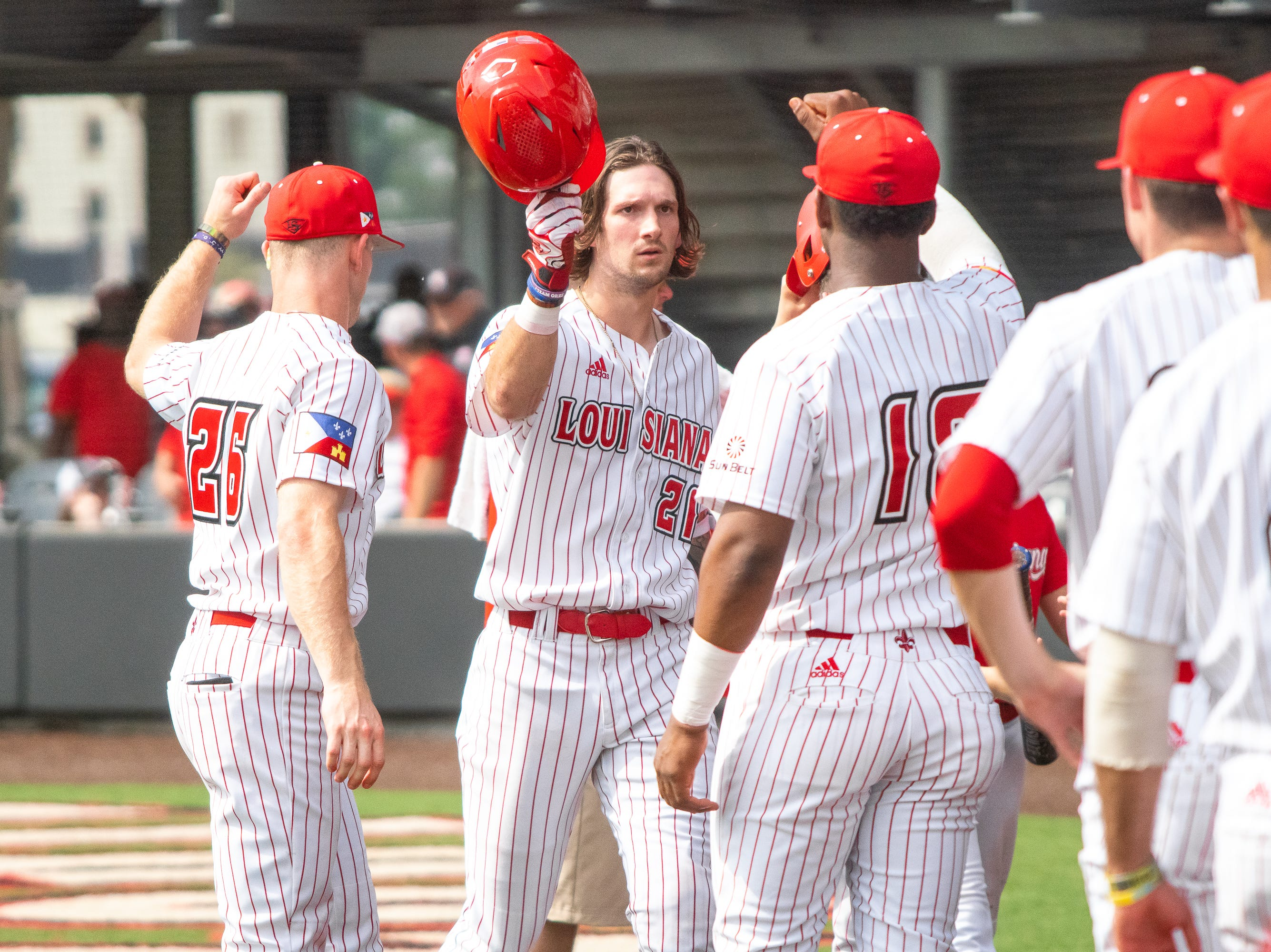 UL's dugout congratulates Orynn Veillon after his homerun score as the Ragin' Cajuns take on the Loyola Marymount Lions at M.L. Tigue Moore Field on March 10, 2019.