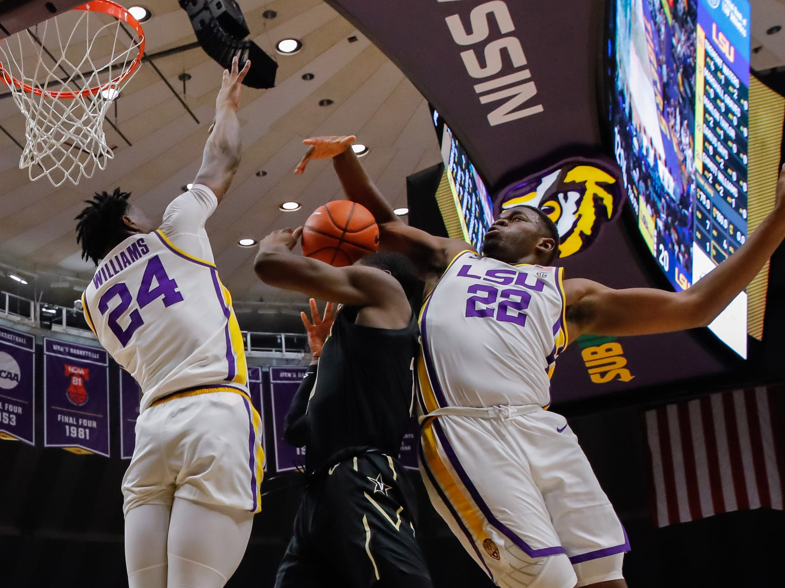 Mar 9, 2019; Baton Rouge, LA, USA; LSU Tigers forward Darius Days (22) and forward Emmitt Williams (24) block the shot of Vanderbilt Commodores forward Matthew Moyer (13) at Maravich Assembly Center. Mandatory Credit: Stephen Lew-USA TODAY Sports