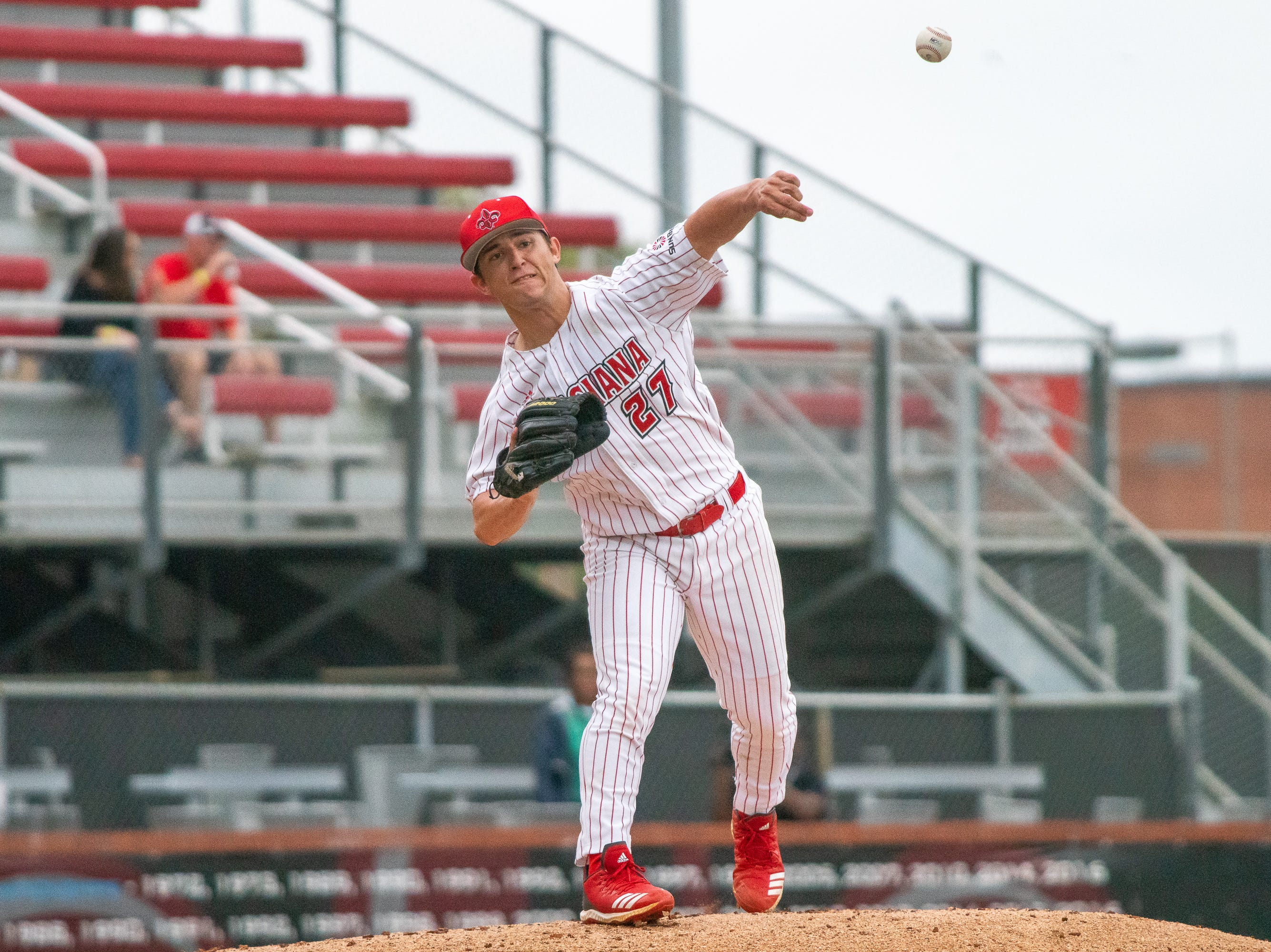 UL's pitcher Austin Perrin throws to first base as the Ragin' Cajuns take on the Loyola Marymount Lions at M.L. Tigue Moore Field on March 10, 2019.