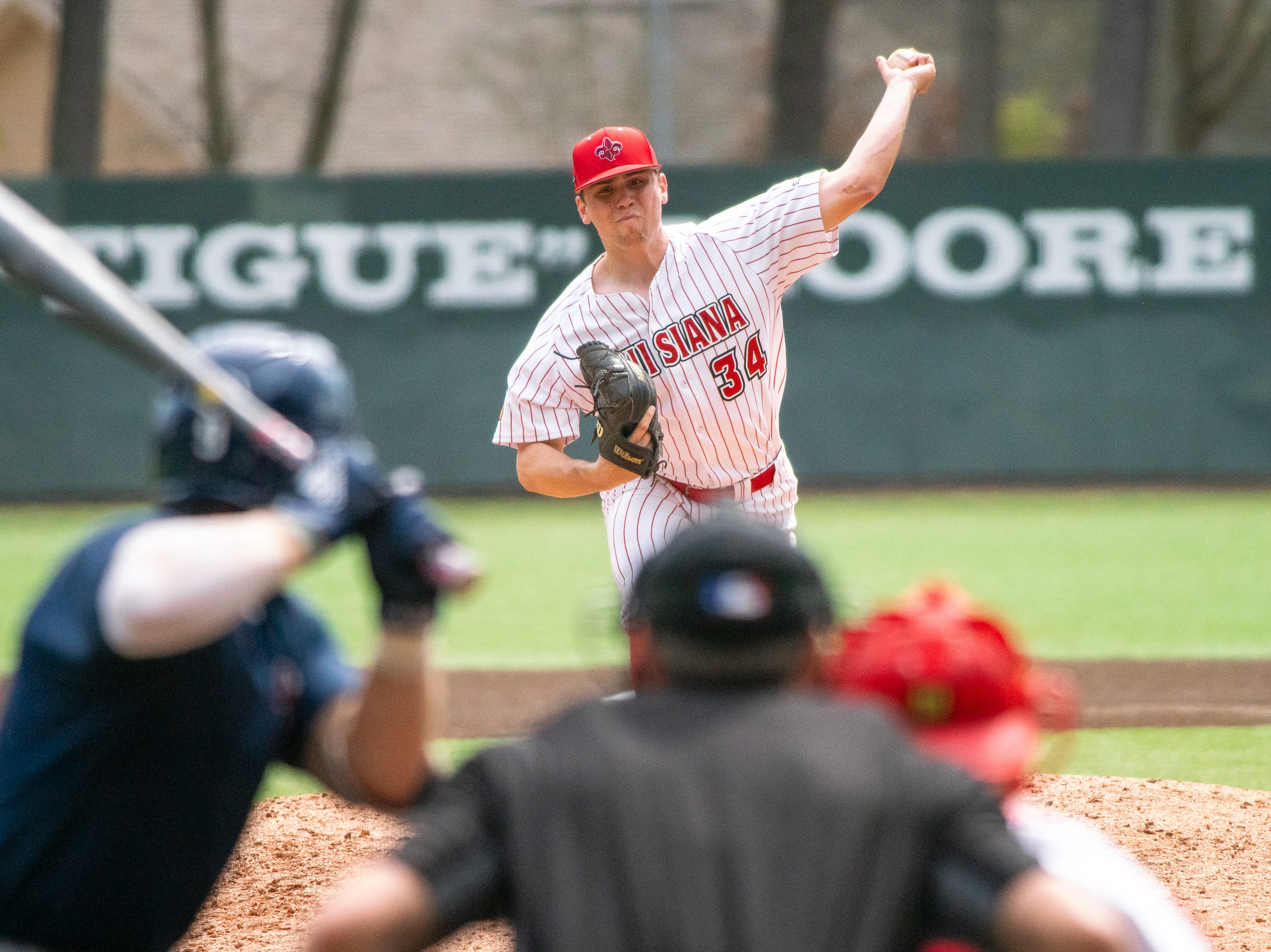 UL's Grant Cox pitches to the batter as the Ragin' Cajuns take on the Loyola Marymount Lions at M.L. Tigue Moore Field on March 10, 2019.