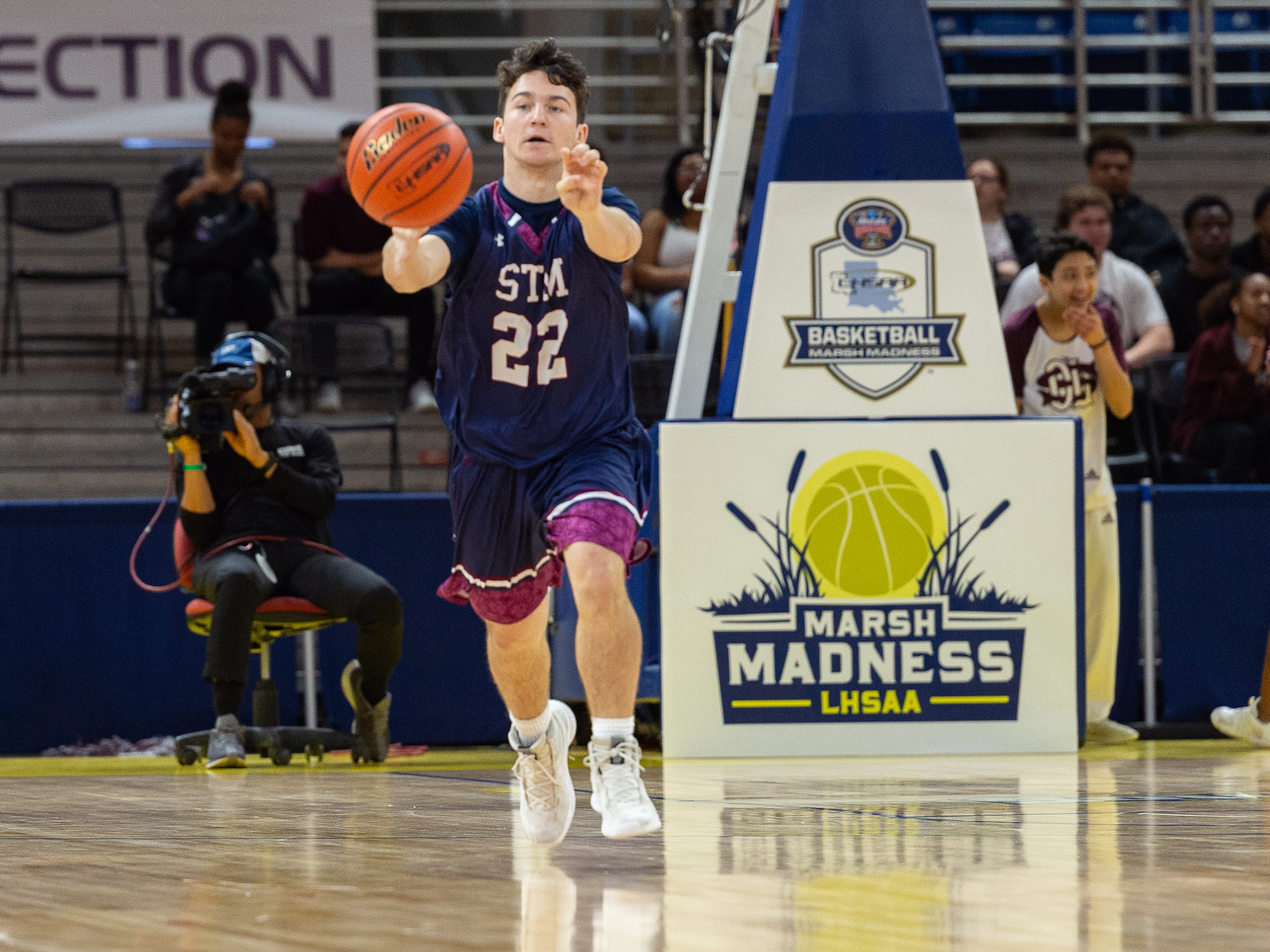 Tobin Thevenot passes the ball as The STM Cougars beat DeLaSalle in double overtime to win the Allstate Sugar Bowl/LHSAA Boys' Marsh Madness Div II State Championship. Saturday, March 9, 2019.