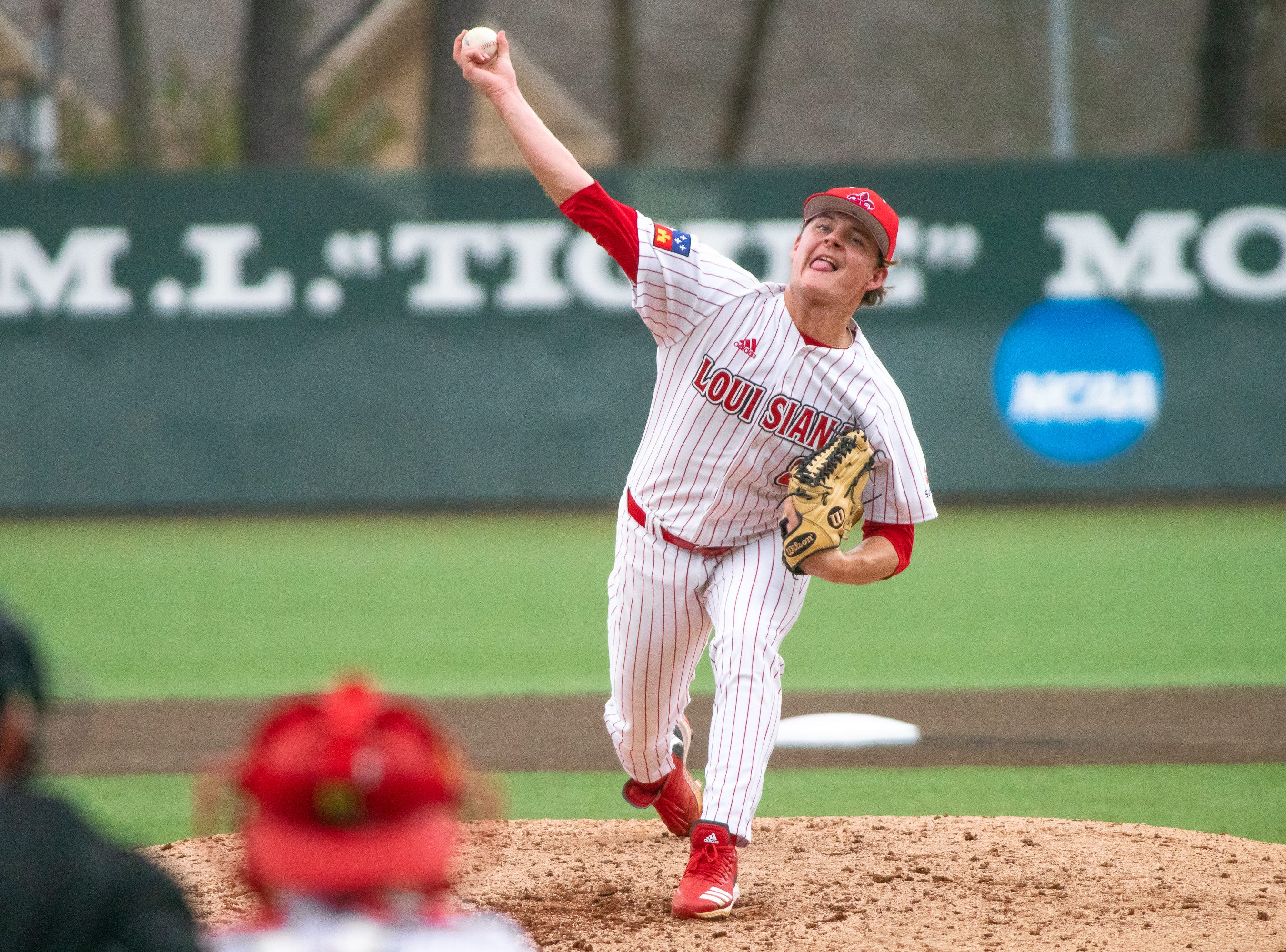 UL's Blake Schultz throws a pitch from the mound as the Ragin' Cajuns take on the Loyola Marymount Lions at M.L. Tigue Moore Field on March 10, 2019.