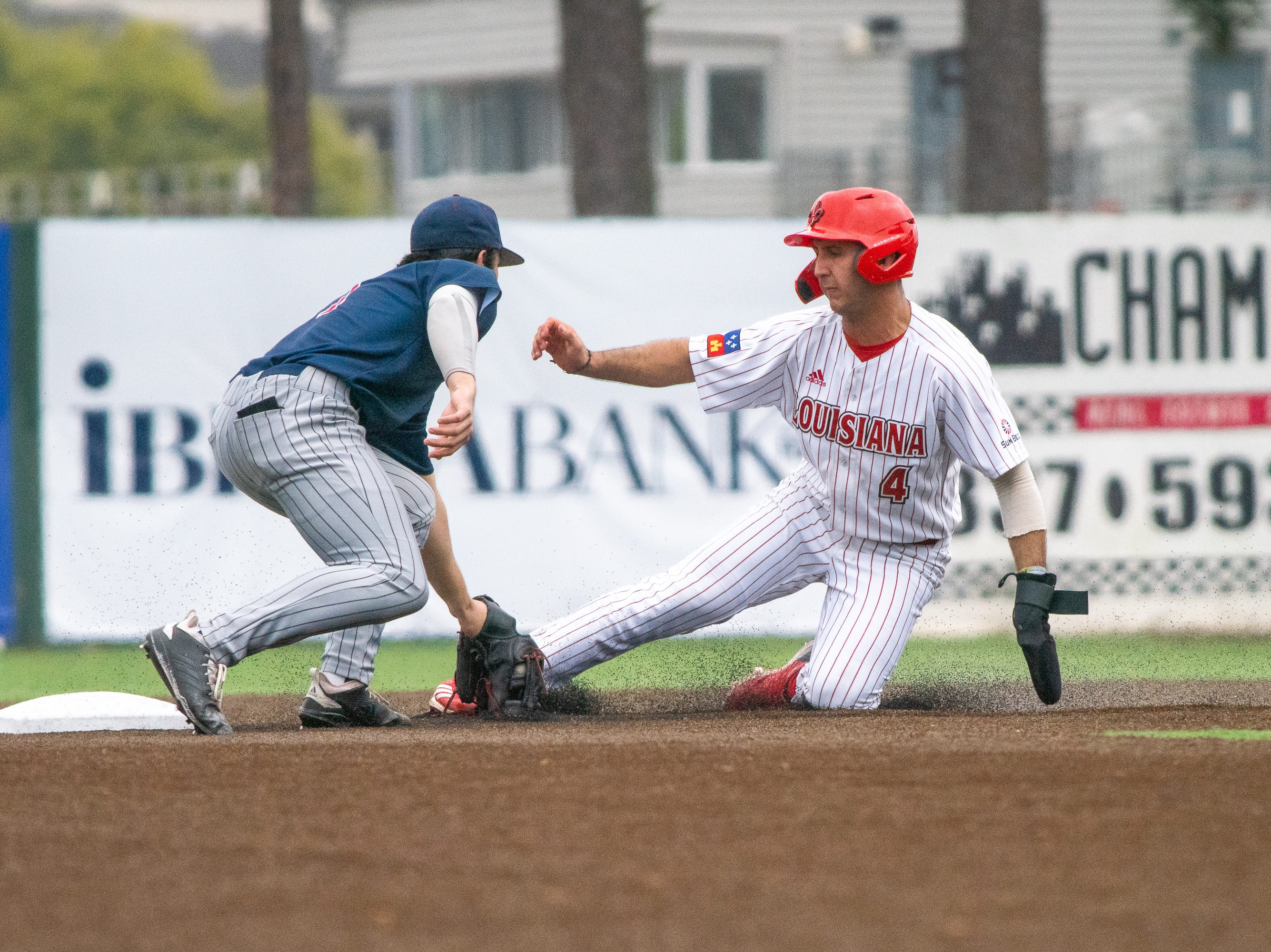 UL's Brennan Breaux gets tagged while sliding onto second base as the Ragin' Cajuns take on the Loyola Marymount Lions at M.L. Tigue Moore Field on March 10, 2019.
